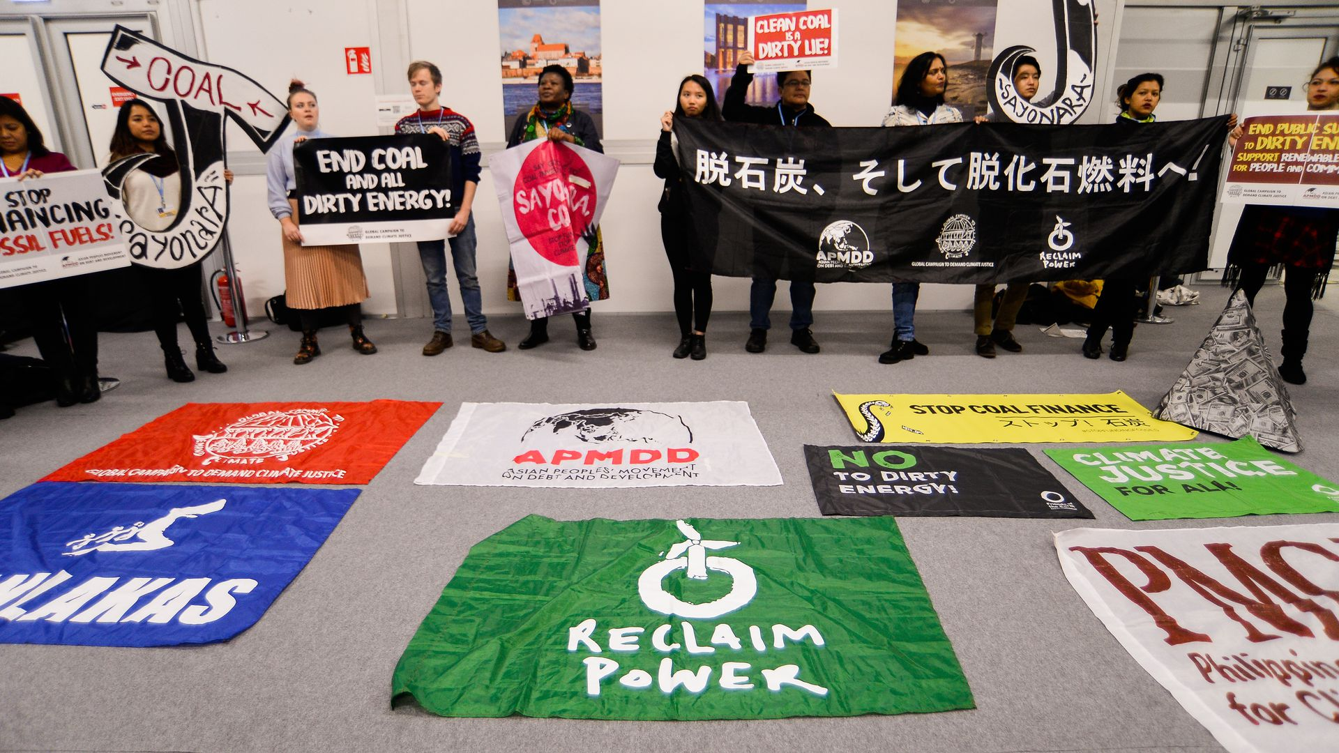 Protestors highlight the divide at a global climate conference around fossil fuels.