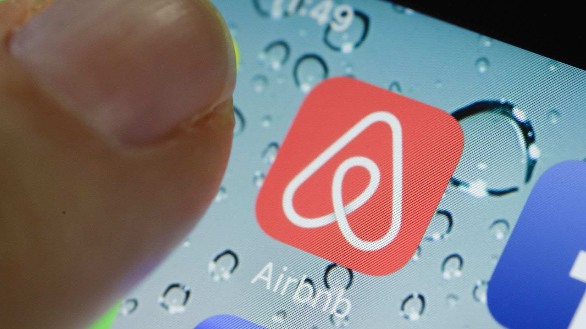 Photo of close-up icon of Airbnb's mobile app.
