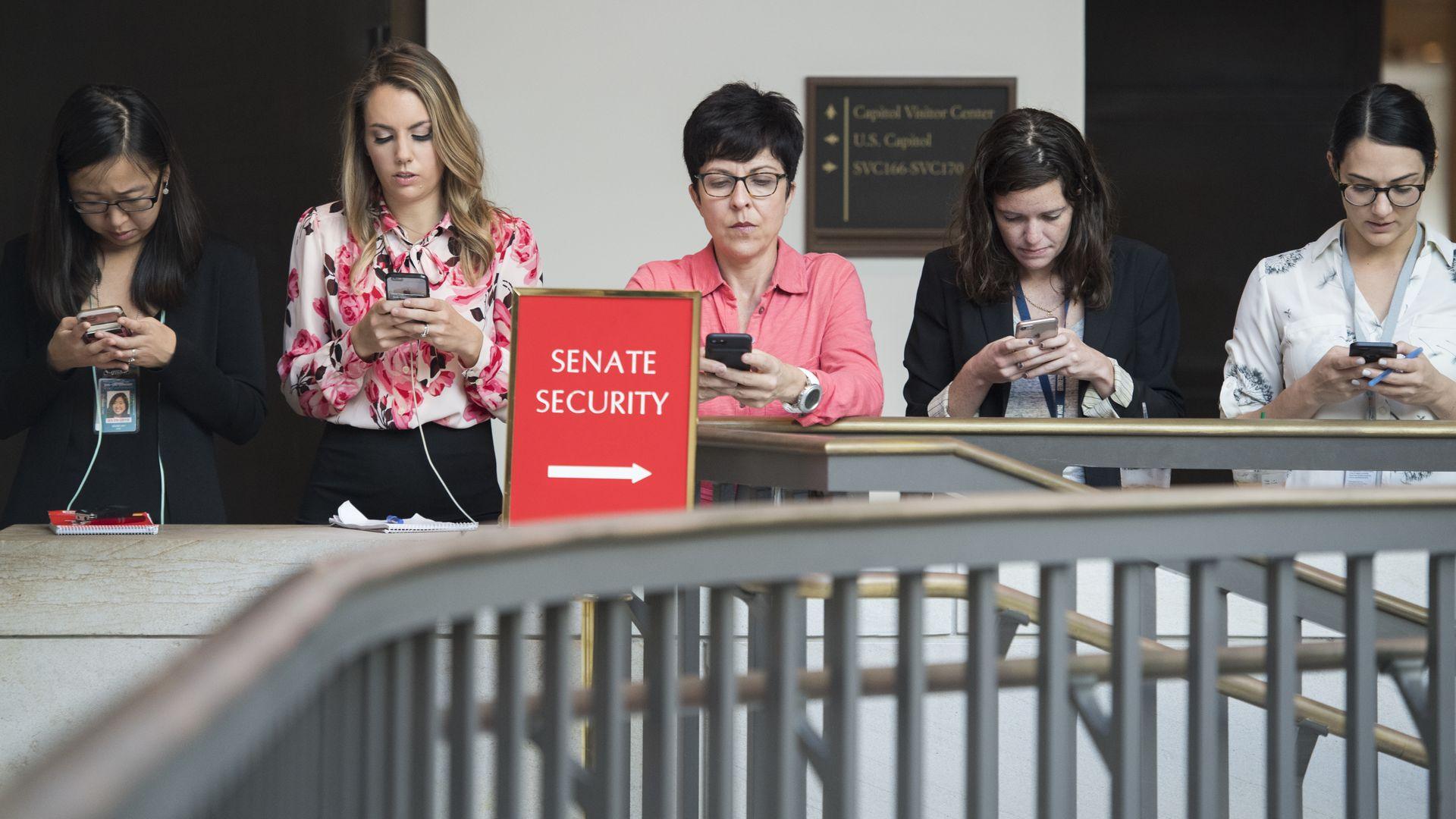 people on smart phones