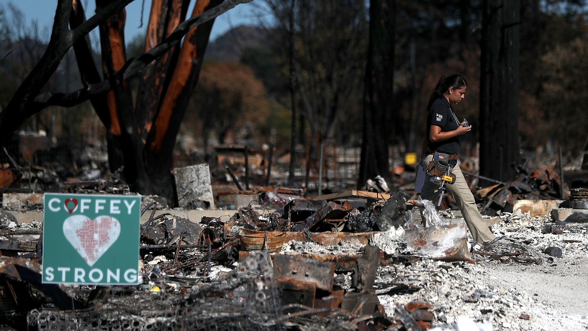 An insurance adjuster walks through a Coffey Park home that was destroyed by the Tubbs Fire on October 23, 2017 in Santa Rosa, California.