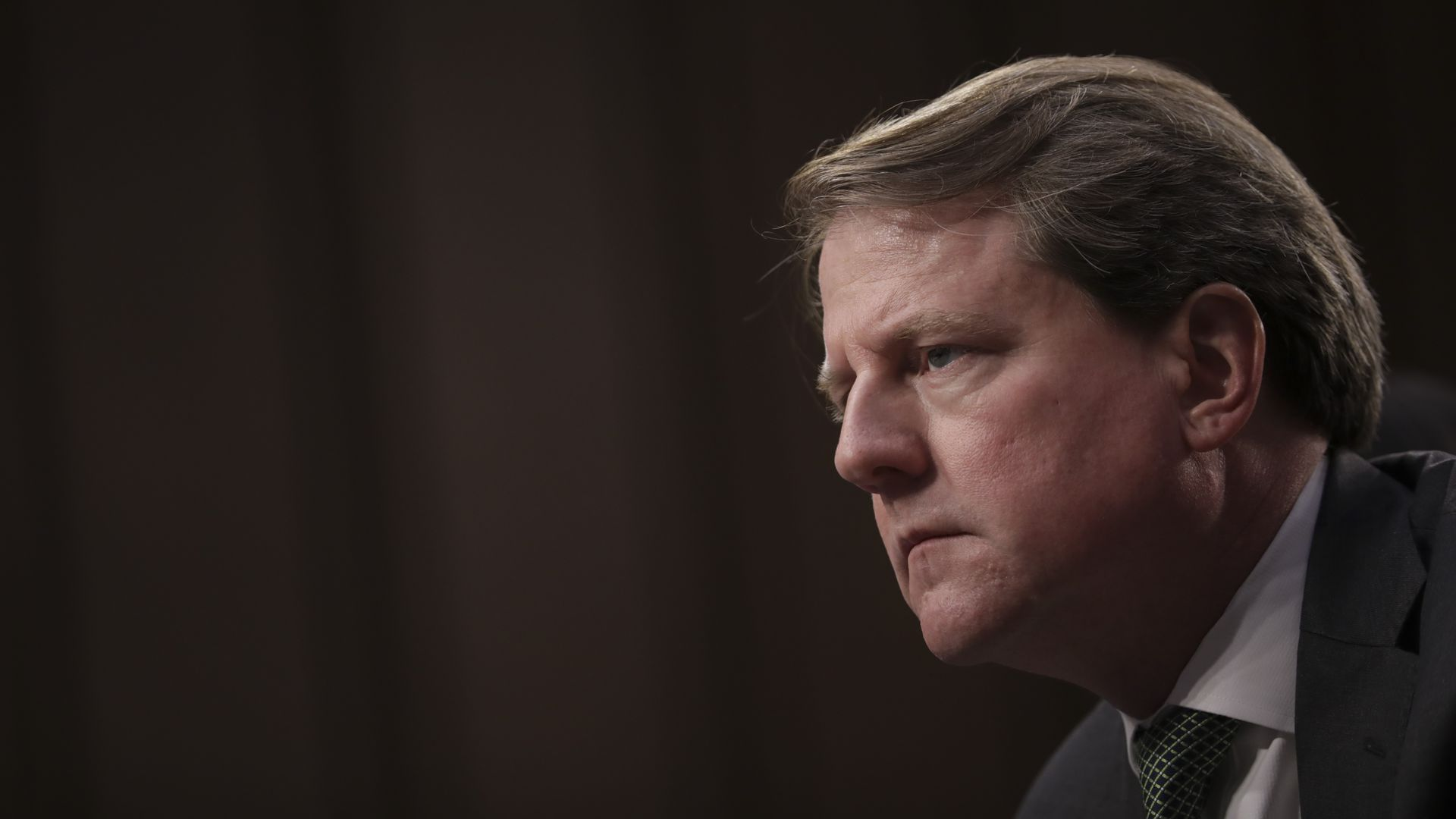 In this image, Don McGahn looks to the left.