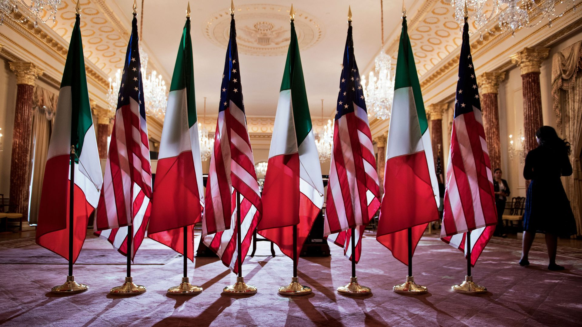 U.S. and Mexico flags stand side-by-side.