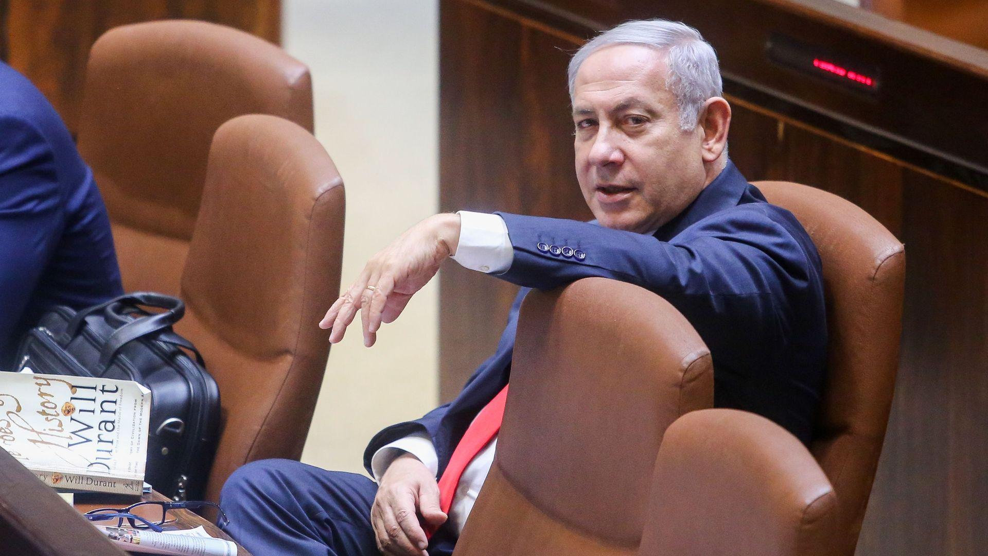 Bibi Netanyahu sitting in Israeli parliament chamber