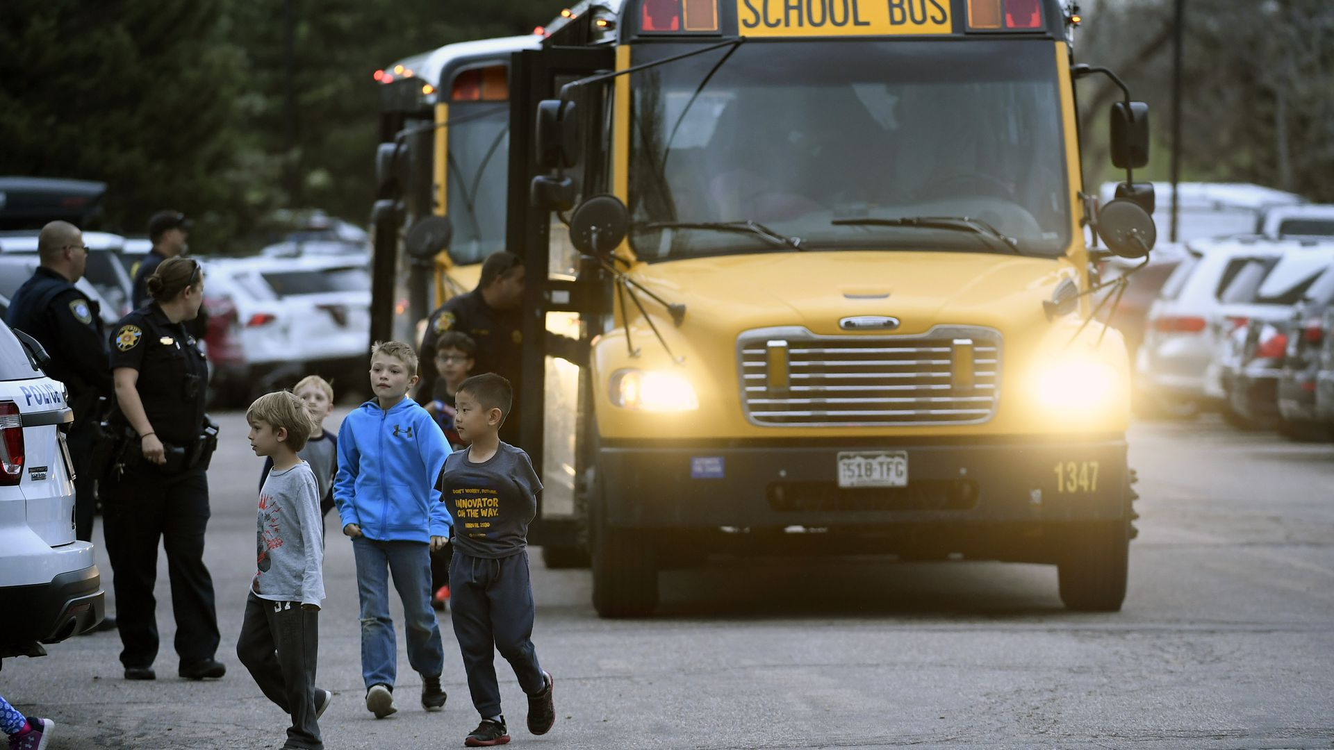 Kids of all ages are brought off buses to be reunited with their parents at the Highlands Ranch Recreation Center at Northridge after a shooting at the STEM school on Tuesday.