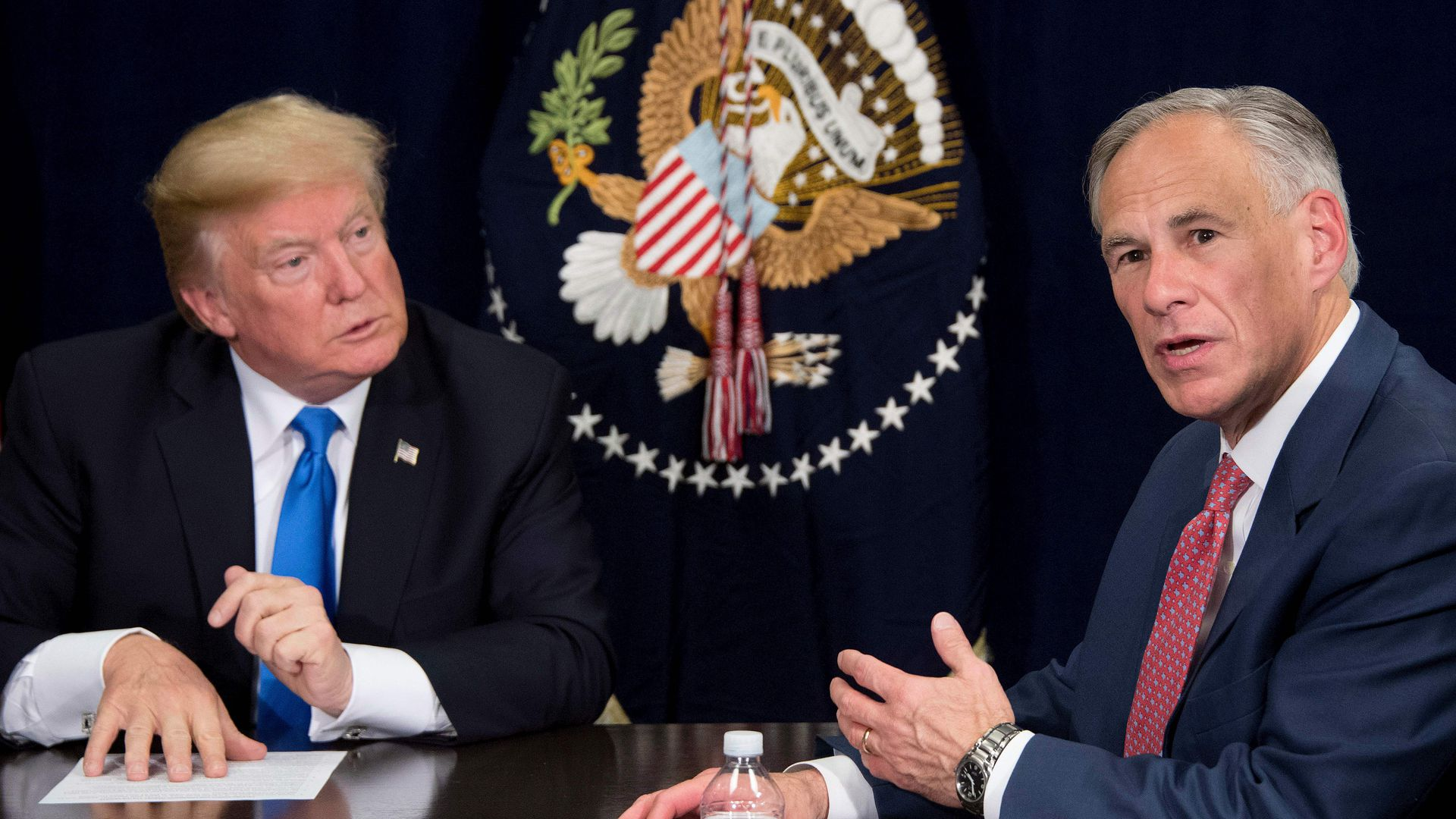 Texas Governor Greg Abbott sitting down and talking to President Donald Trump