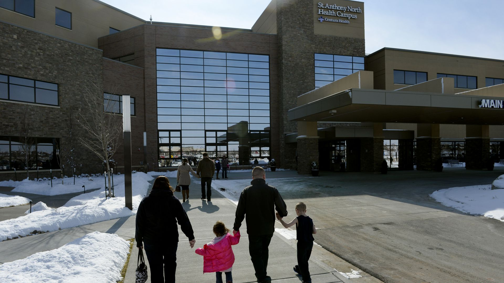 A family walks into the St. Anthony North Hospital in Colorado.