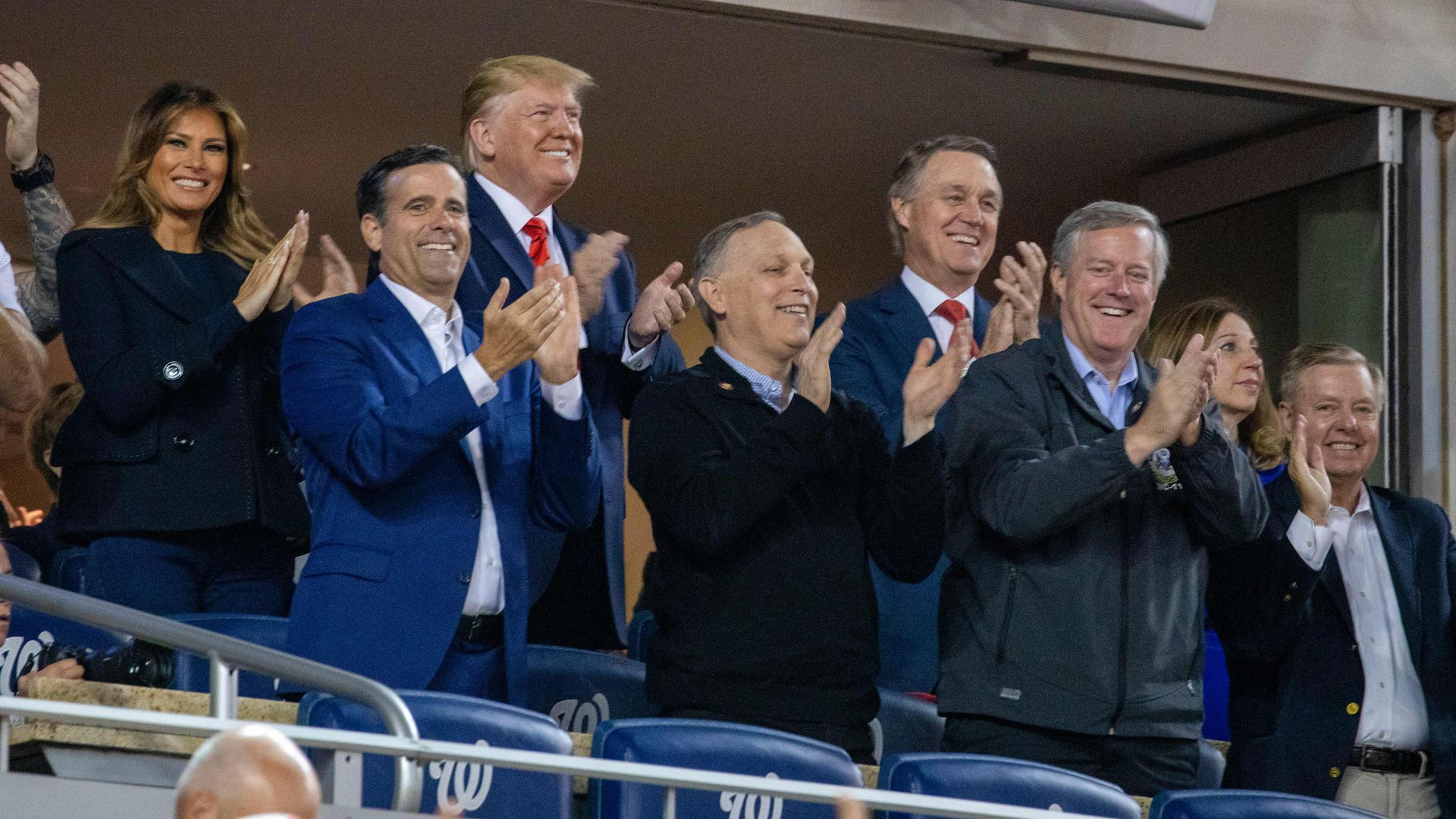 US President Donald Trump (C) and First Lady Melania Trump (2L) with Republican lawmakers during the World Series between the Washington Nationals and Houston Astros