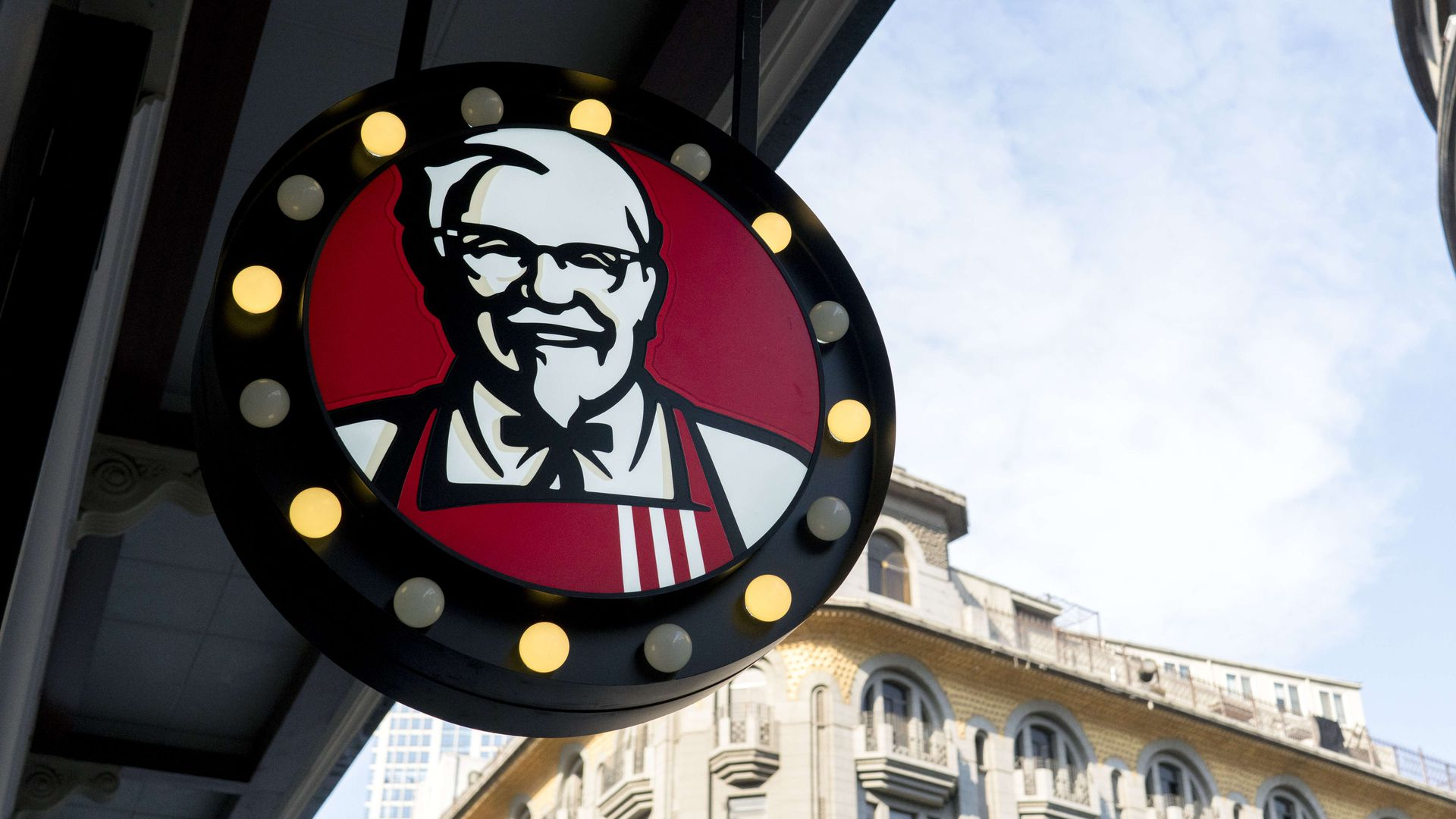 Colonel Sanders portrait on logo of a KFC restaurant.