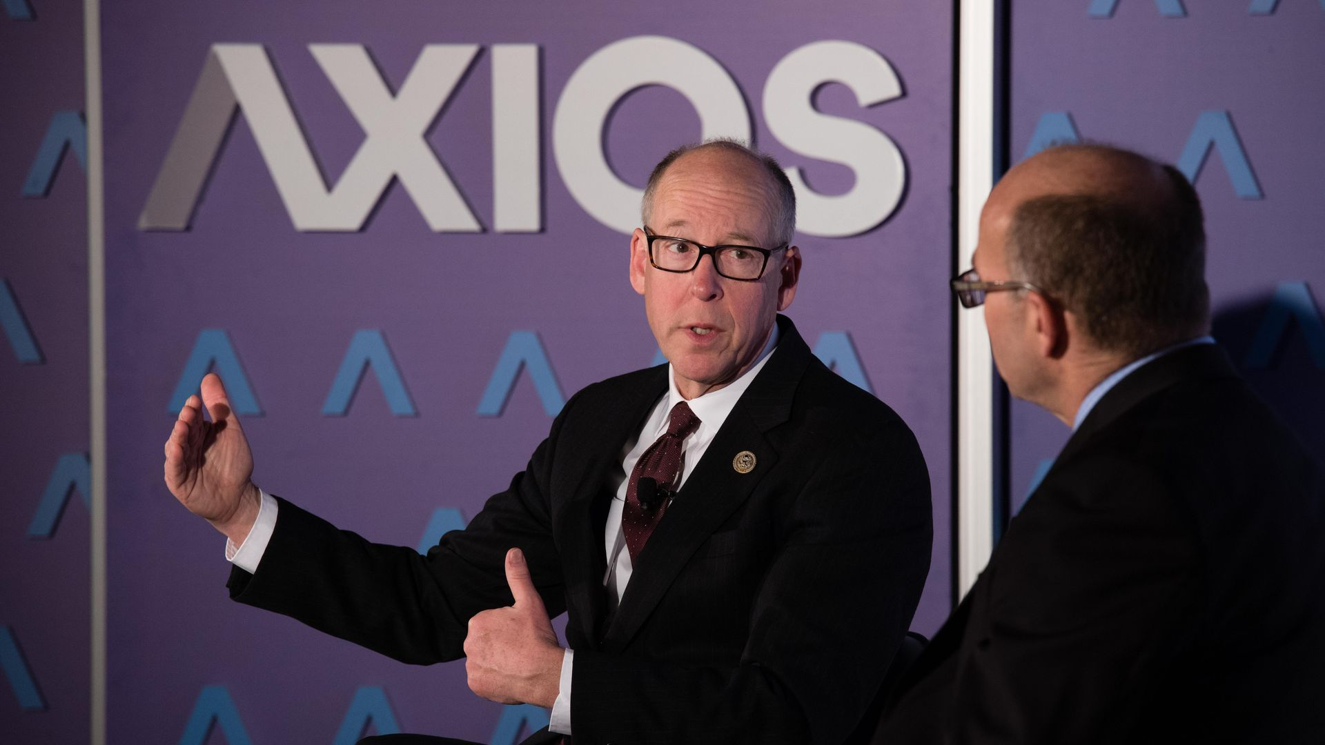 Rep. Greg Walden in front of an Axios logo