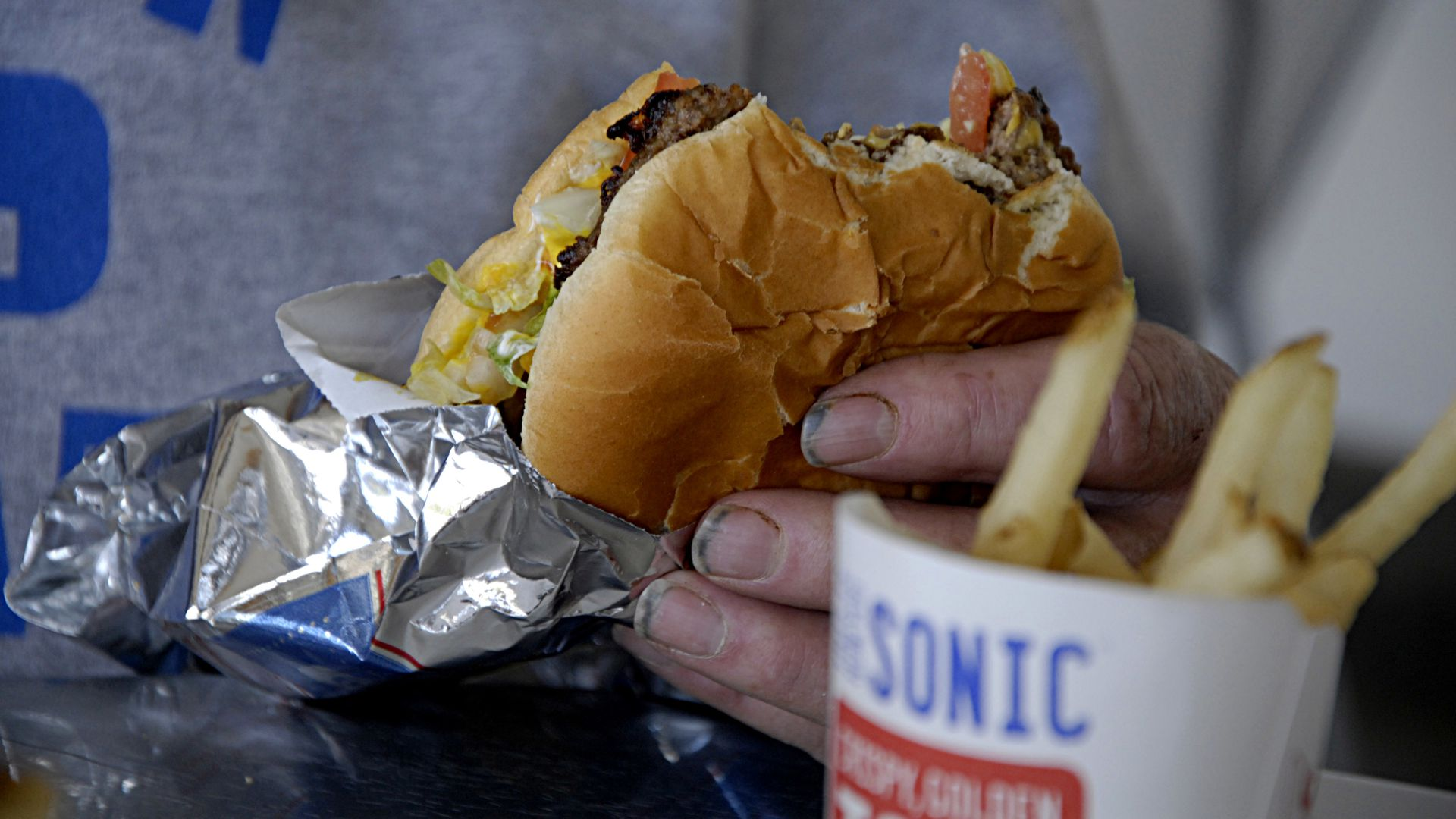 A burger and french fries from a Sonic restaurant.