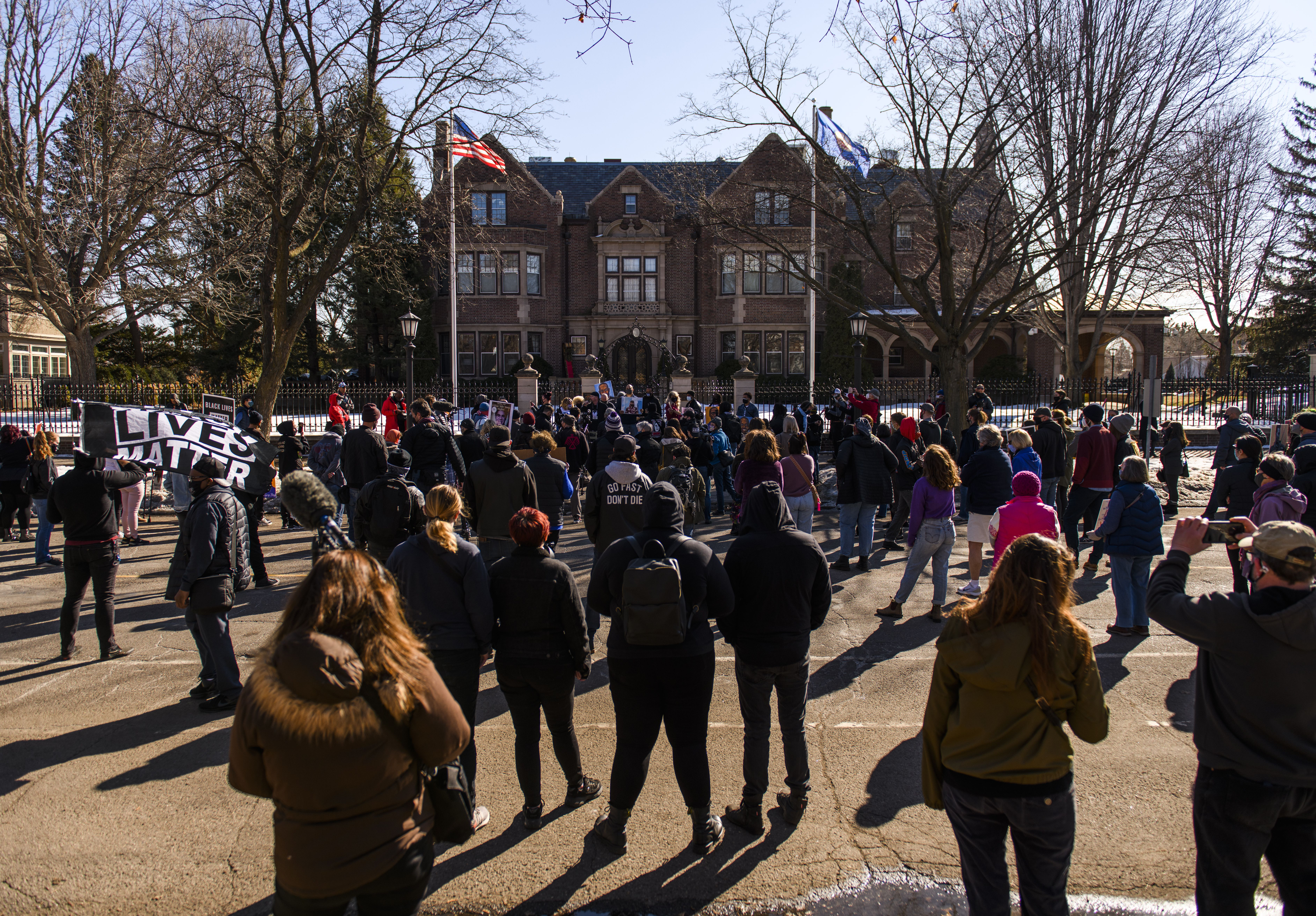 People gather for a protest demonstration outside the Governors Mansion on March 6, 2021 in St. Paul, Minnesota.