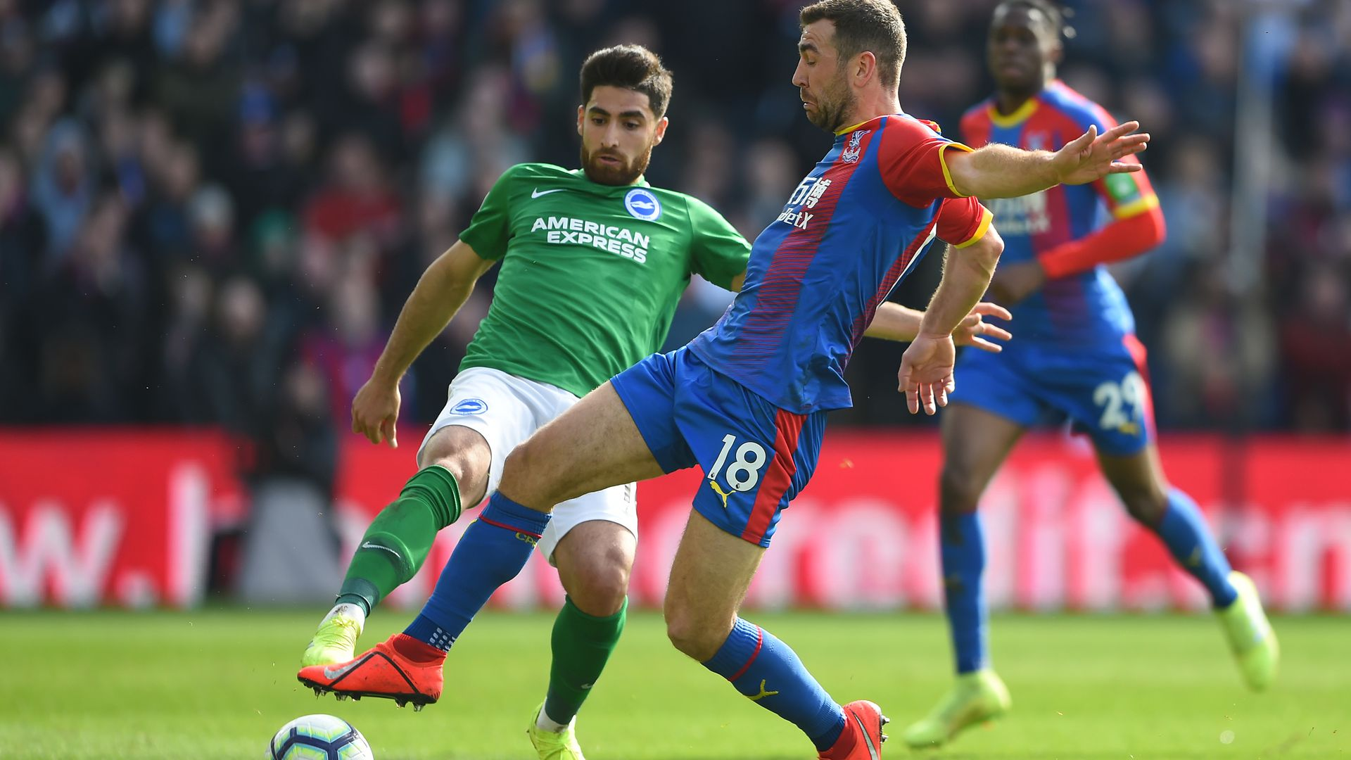 James McArthur of Crystal Palace is challenged by Alireza Jahanbakhsh of Brighton & Hove Albion during the Premier League match between Crystal Palace and Brighton & Hove Albion