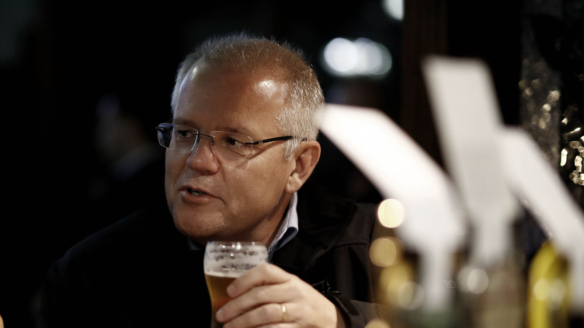 Australia's PM Scott Morrison drinks a beer while campaigning in the Australian federal election.