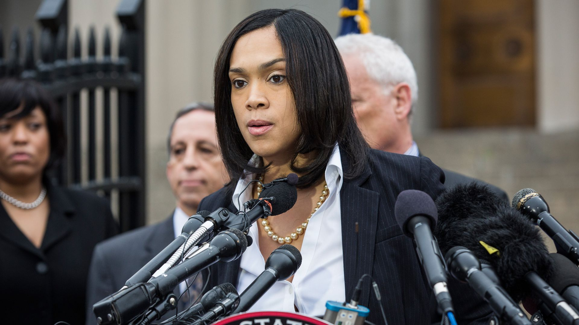 Baltimore State's Attorney Marilyn Mosby behind a podium