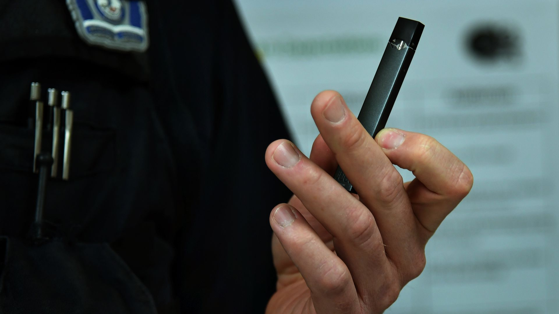 Man holding a juul e cigarette