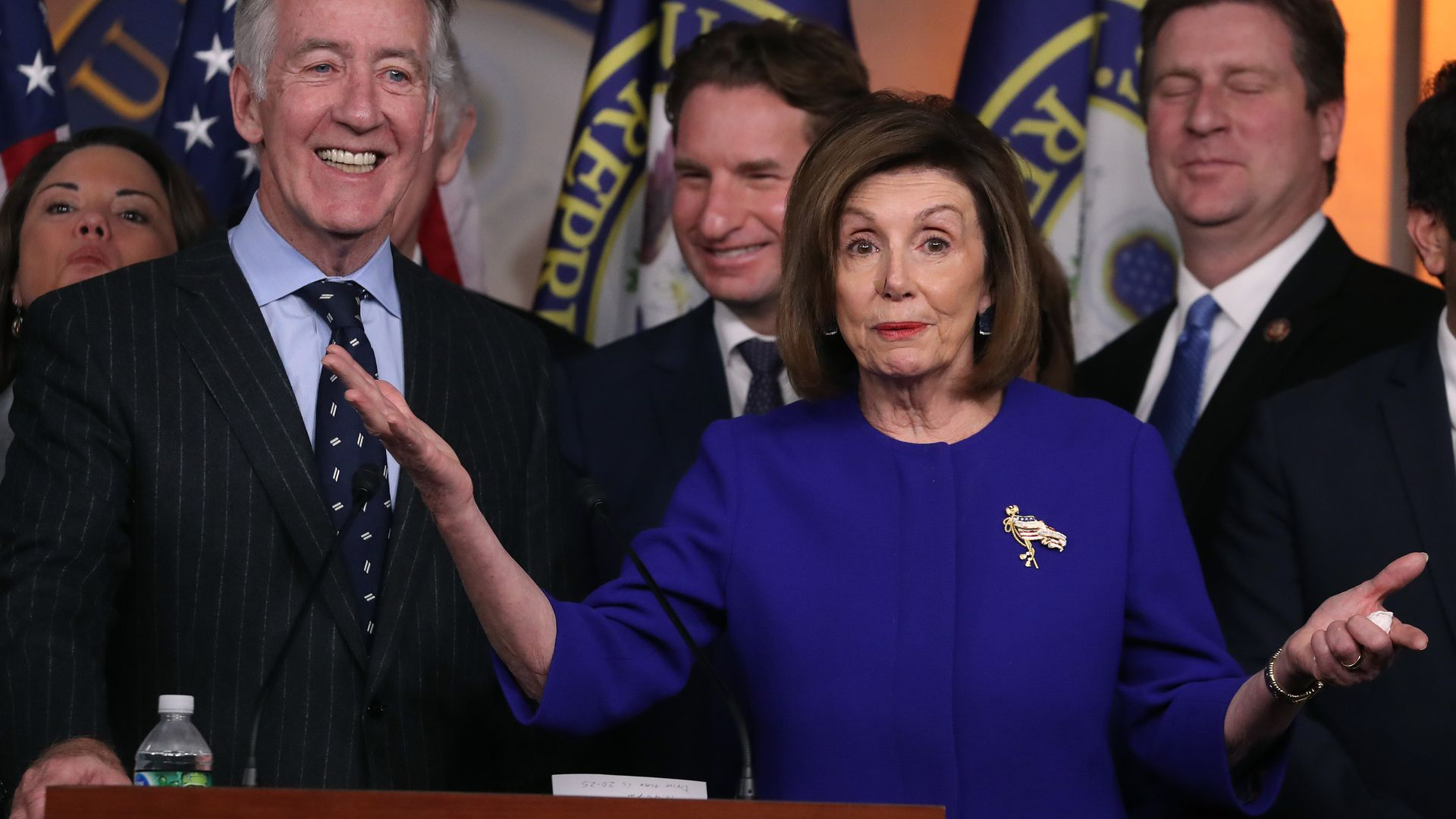 Nancy pelosi with her arms out