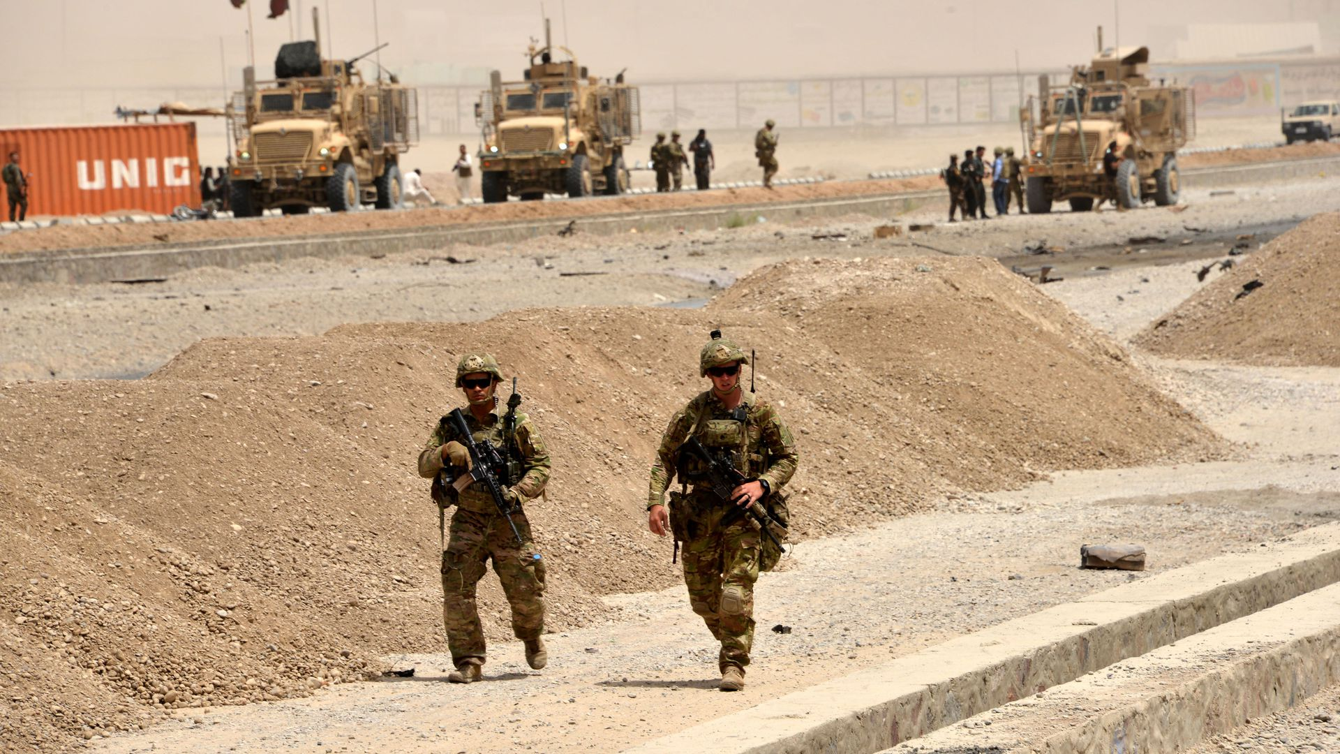 US soldiers walk at the site of a Taliban suicide attack in Kandahar