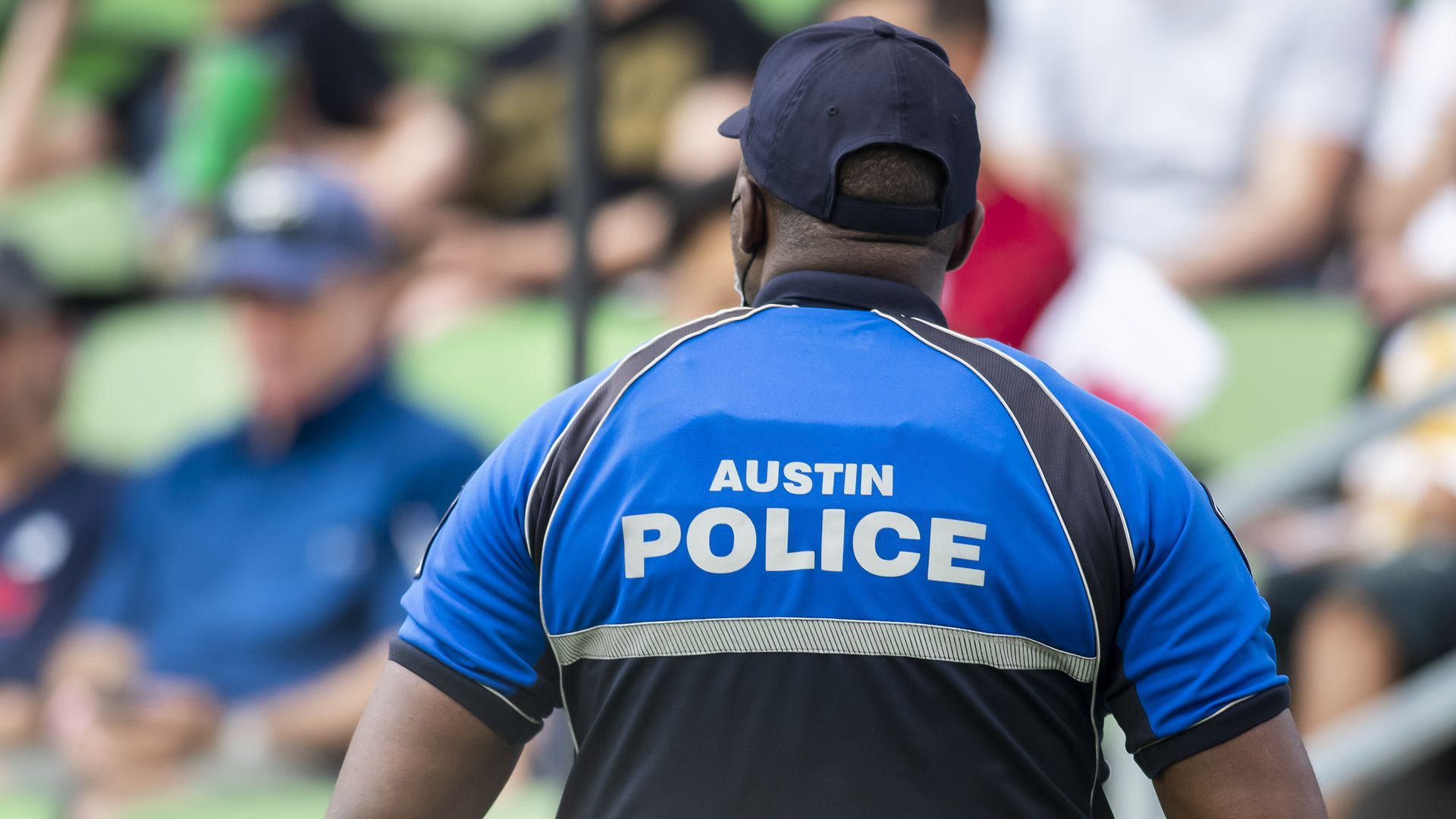An Austin police officer stands watch at soccer match in Austin in July.