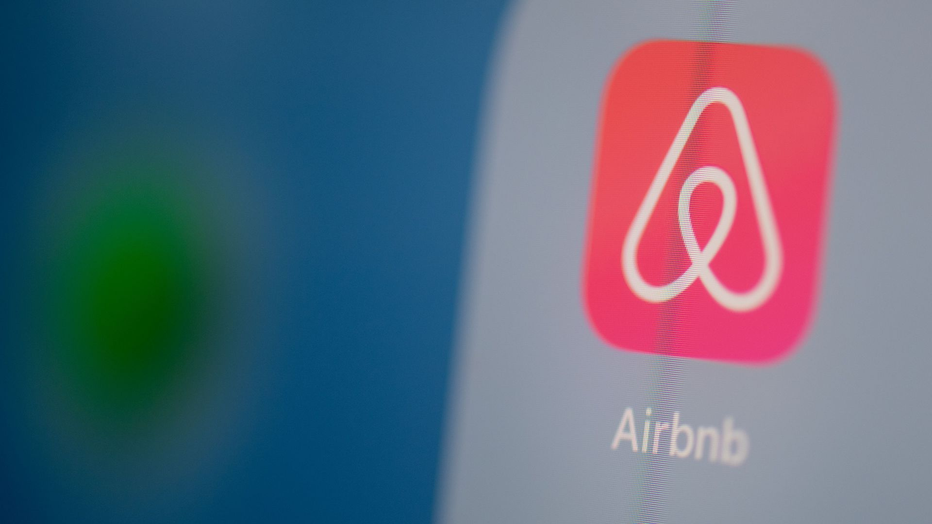 In this image, the Airbnb app is displayed on a smartphone.