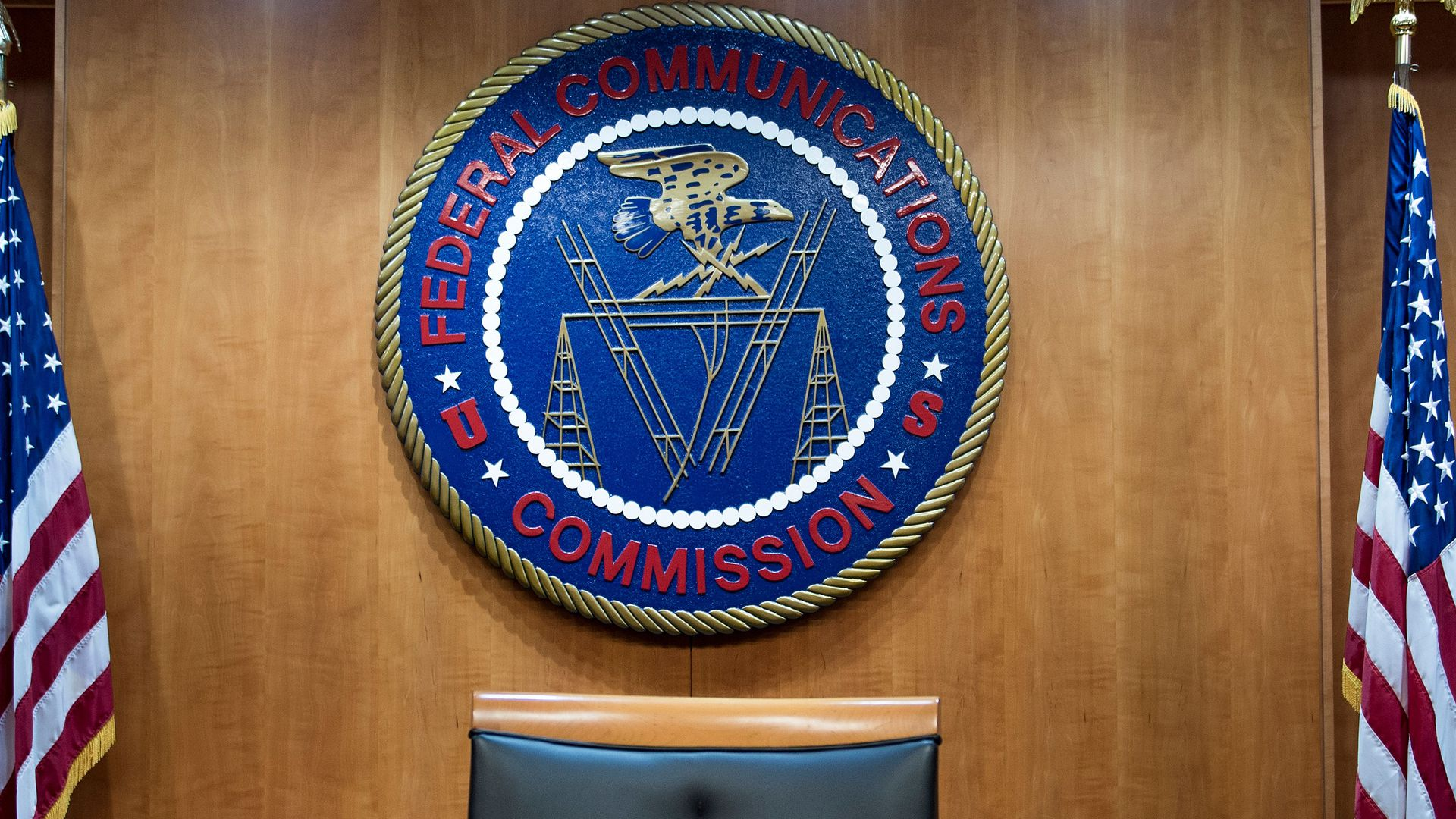 The seal of the FCC mounted on the wall