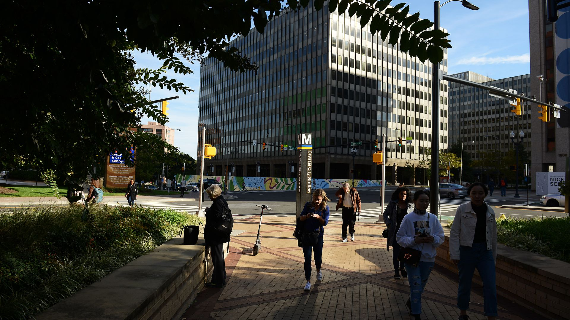 People walking around crystal city metro stop