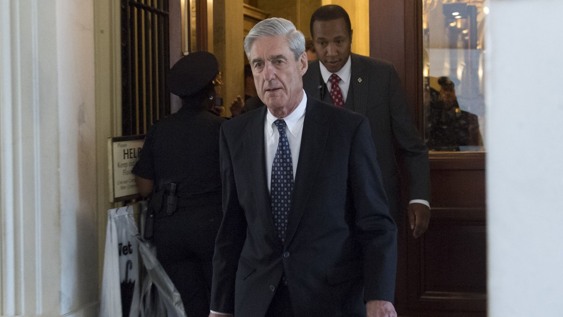 Robert Mueller walks down the stairs of the Capitol