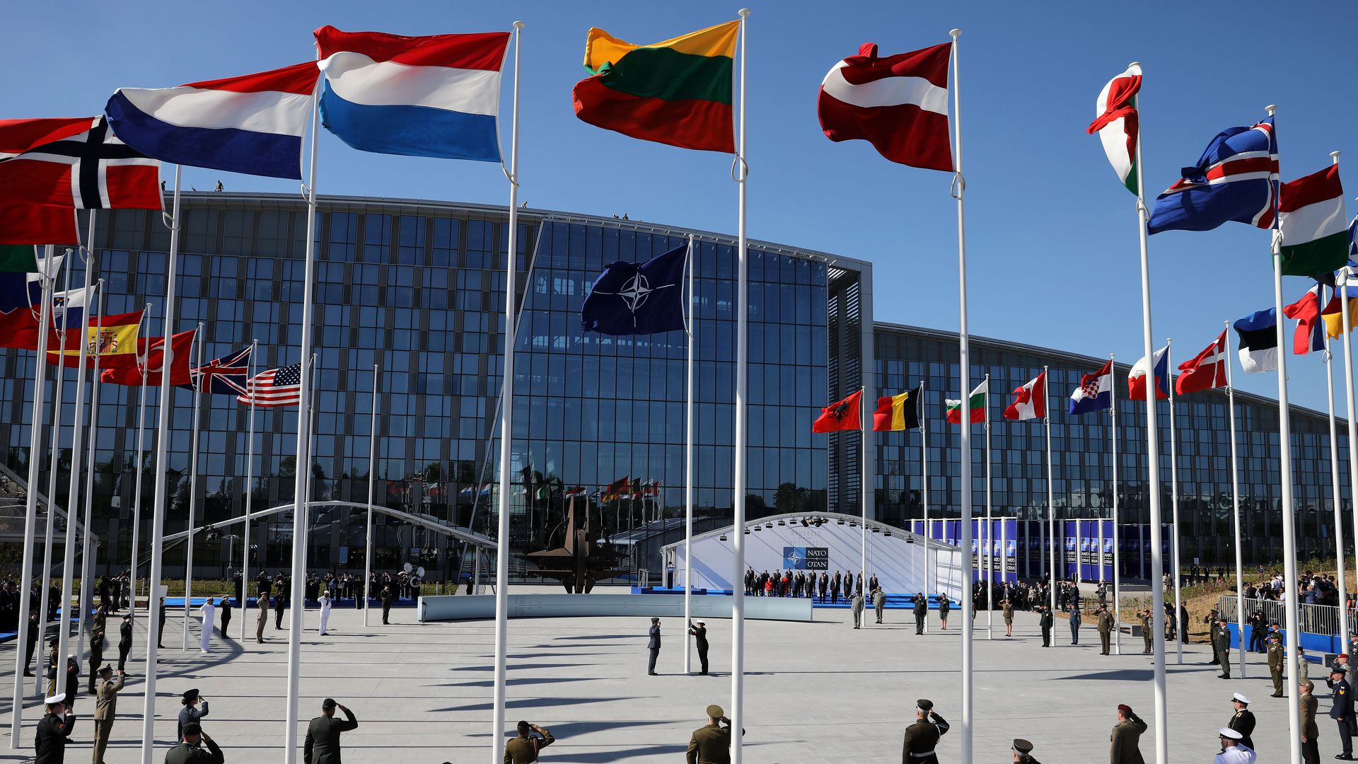 NATO headquarters, with circle of flagpoles and soldiers at attention