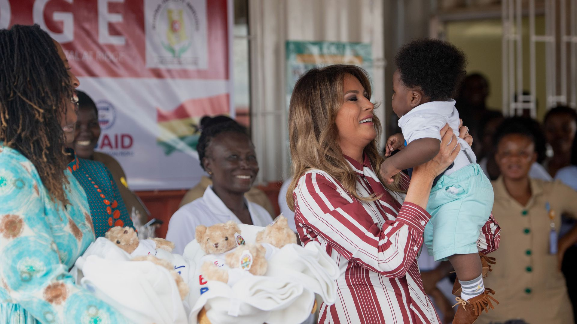 Melania Trump holding a baby.