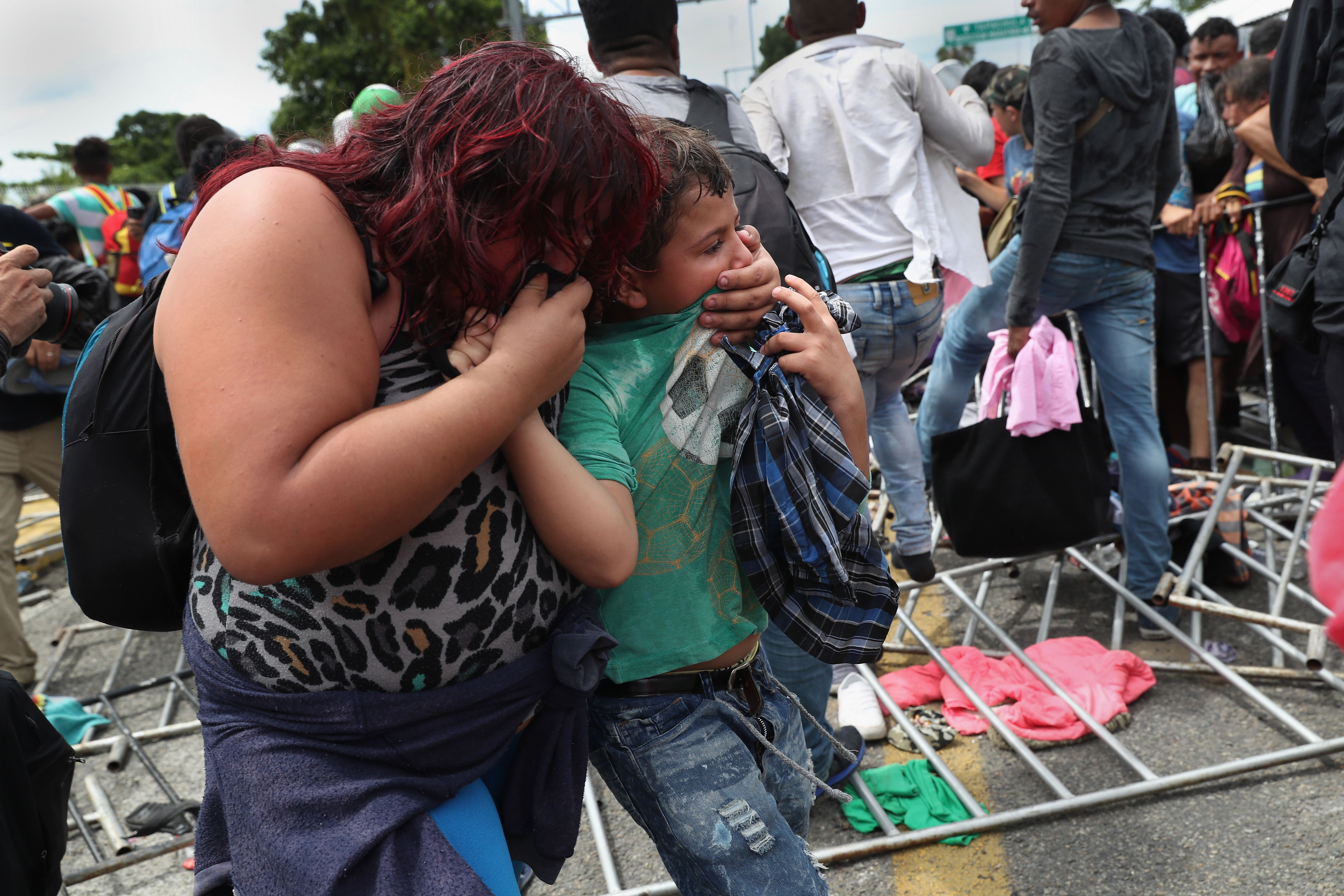 Migrants hit with tear gas