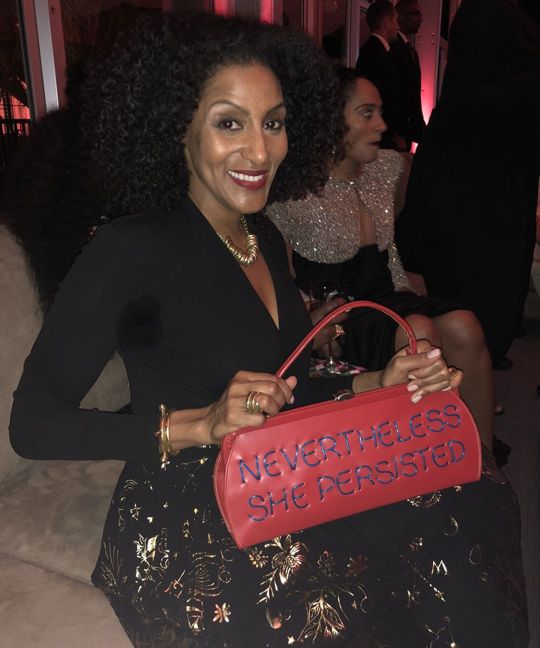 Sarah Jones, who lives in New York and L.A., toted a purse by Michele Pred. (Axios photo)