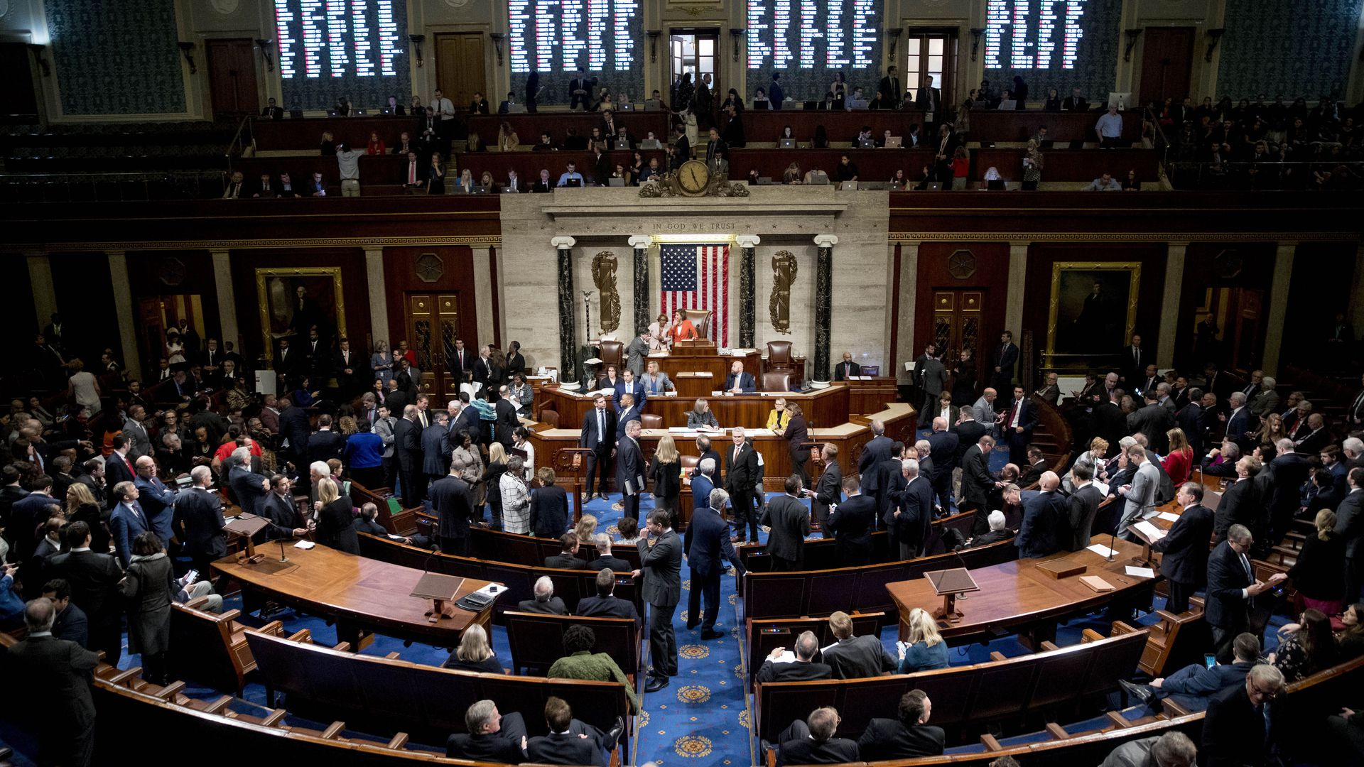 The floor of the House of Representatives packed with Congresspeople.