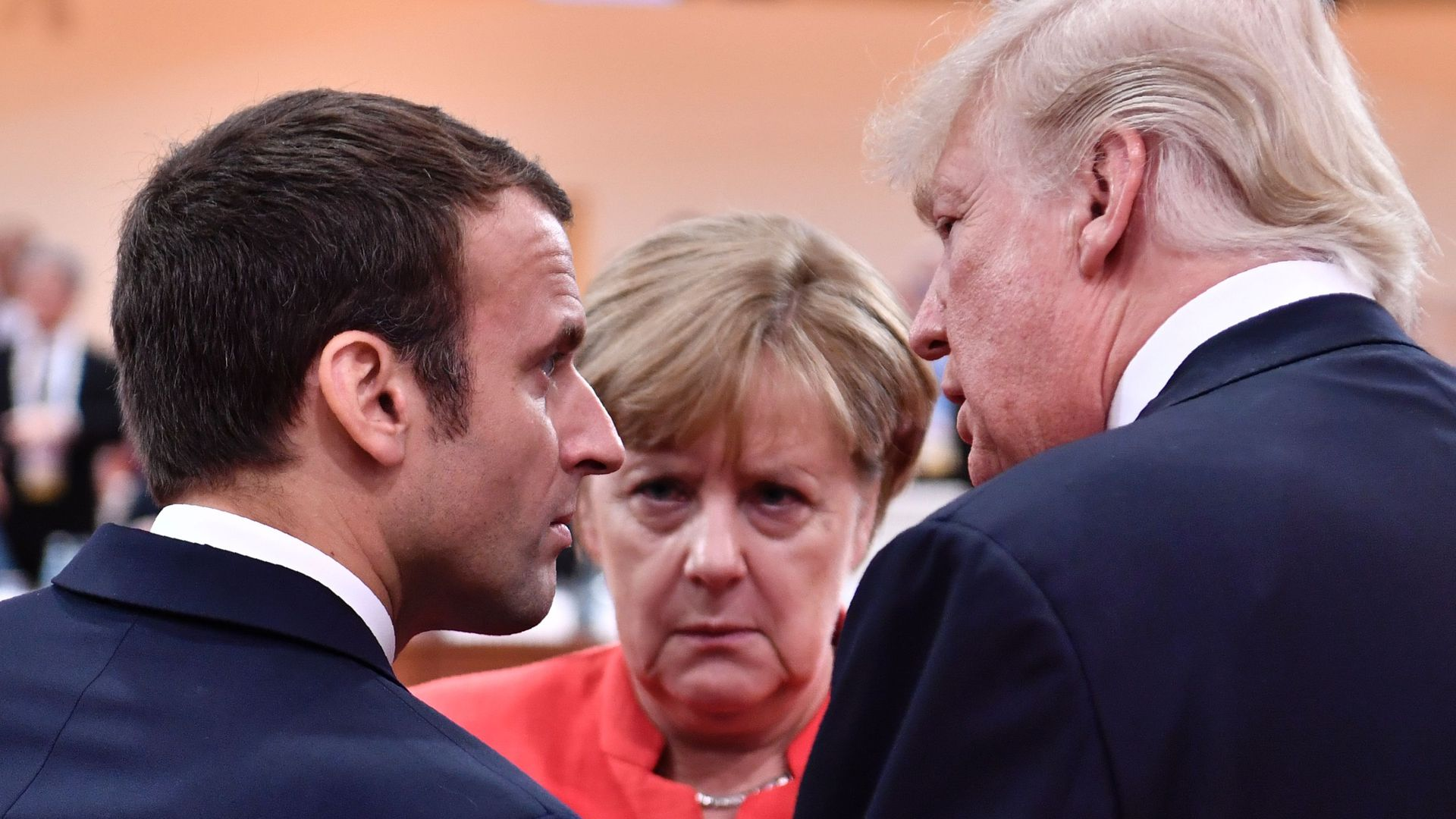 President Trump, French President Emmanuel Macron and German Chancellor Angela Merkel chat at the G20 meeting in Hamburg, Germany, on July 7, 2017