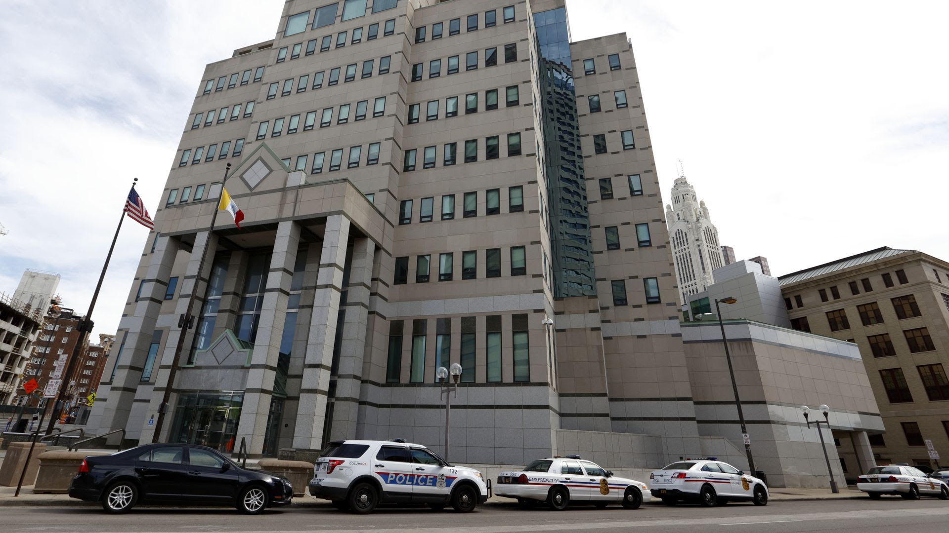 The exterior of the Columbus Division of Police headquarters with police cars lined up outside.