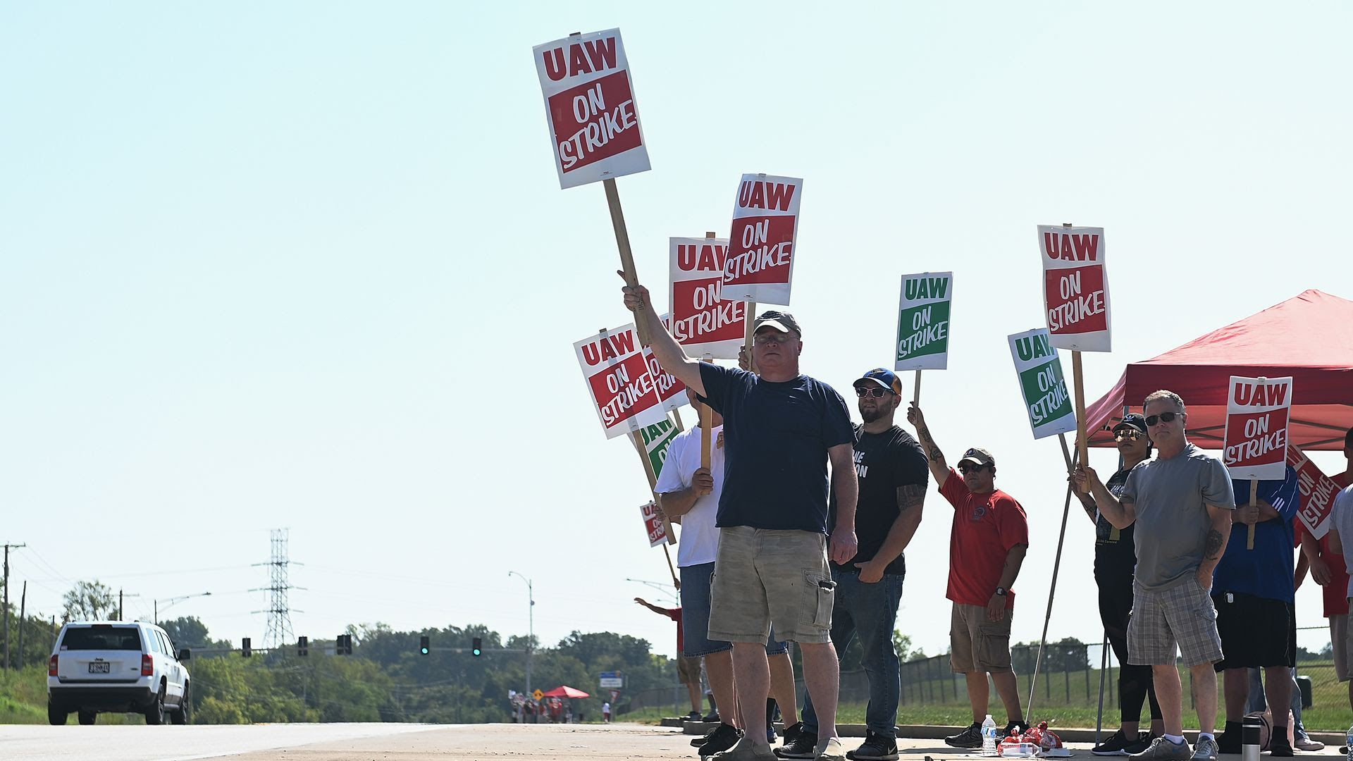 Members of the United Auto Workers Union picket outside the General Motors Assembly Plant