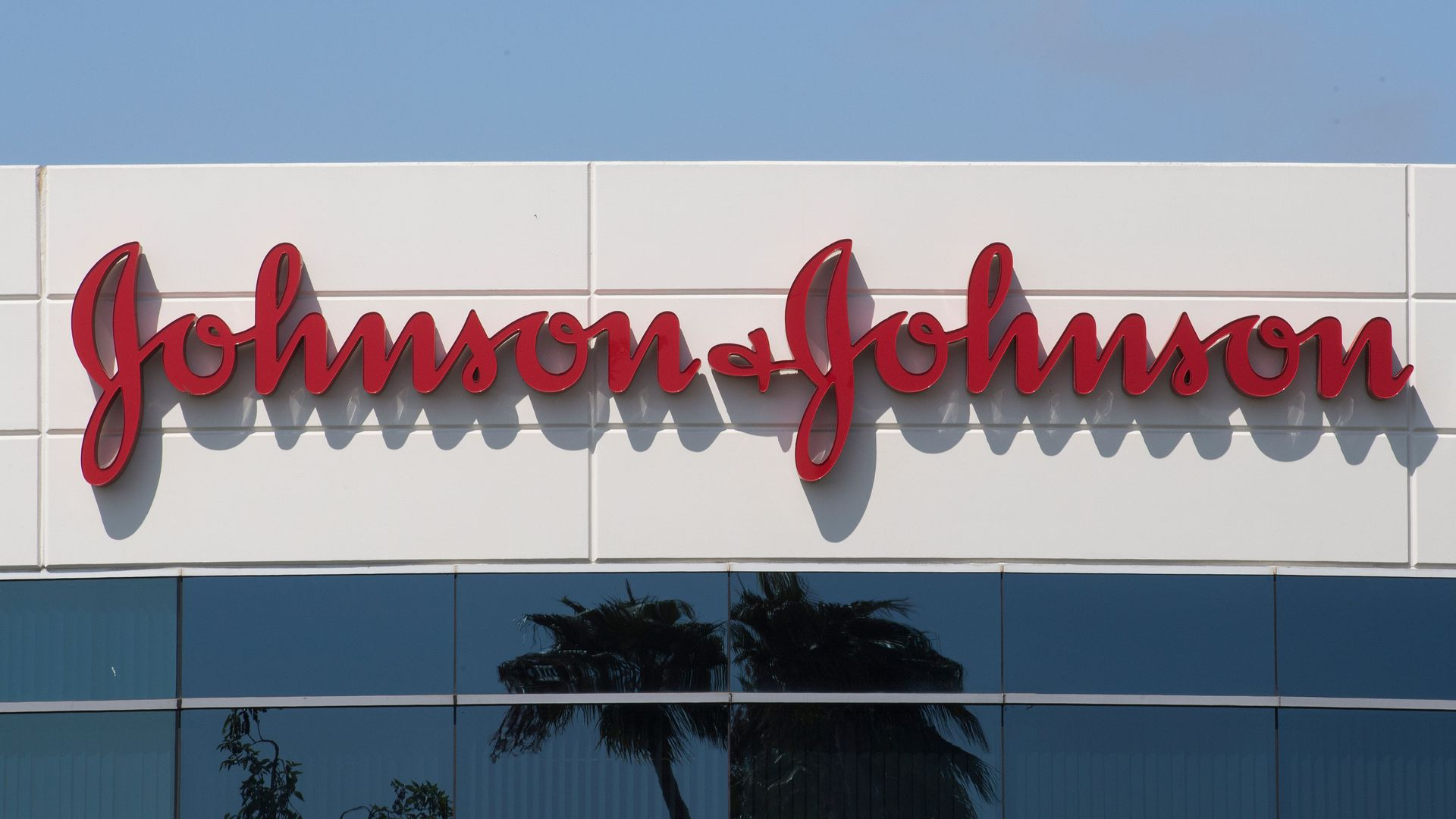 The red Johnson & Johnson logo on a building.