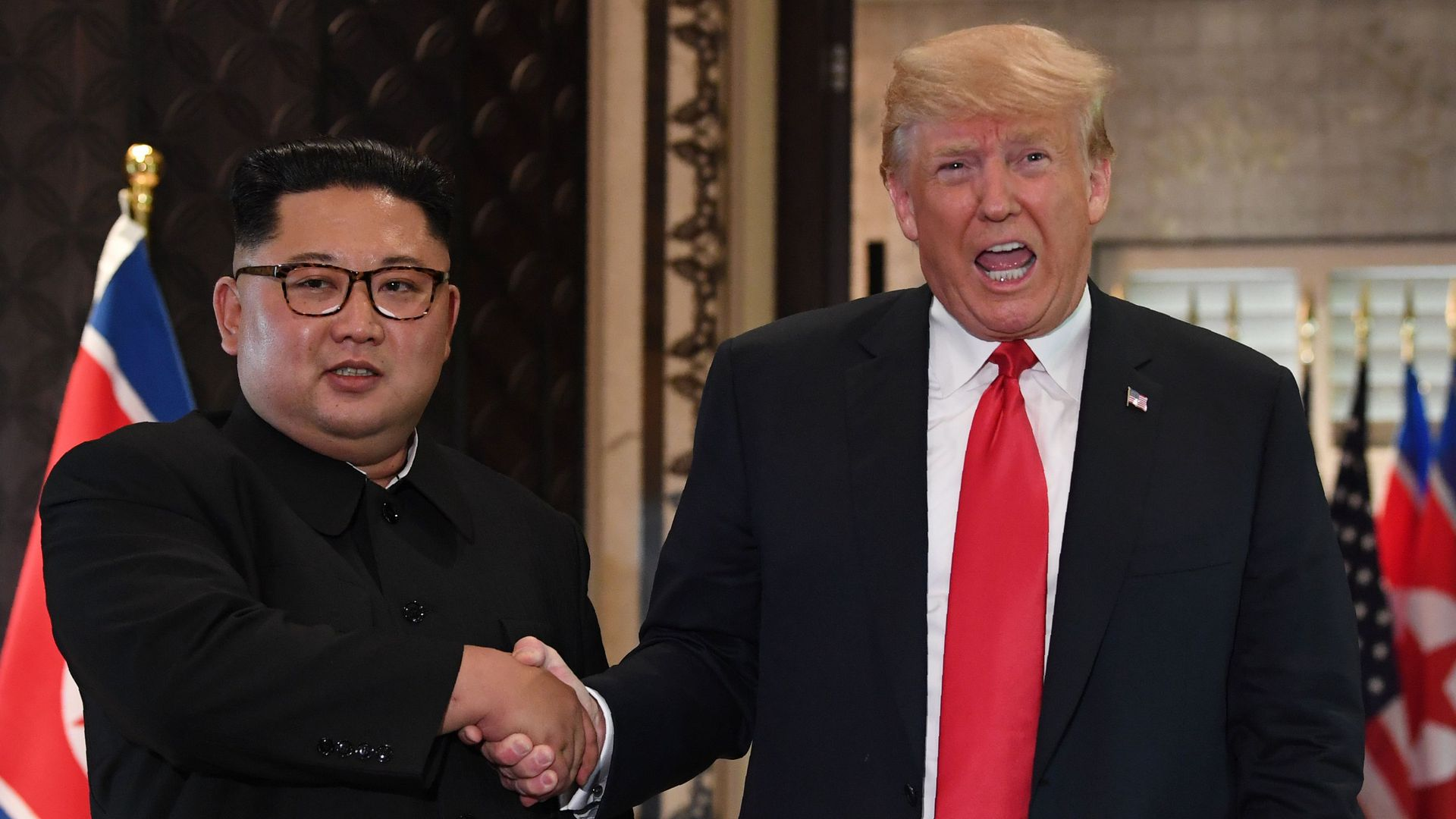 Trump and Kim shake hands