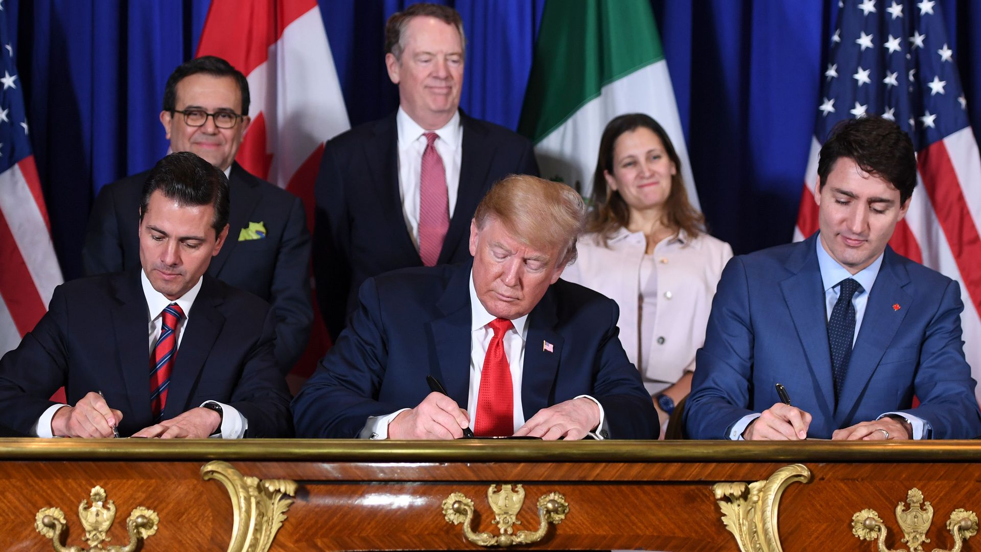 Mexico's President Enrique Pena Nieto US President Donald Trump and Canadian Prime Minister Justin Trudeau signing a trade deal