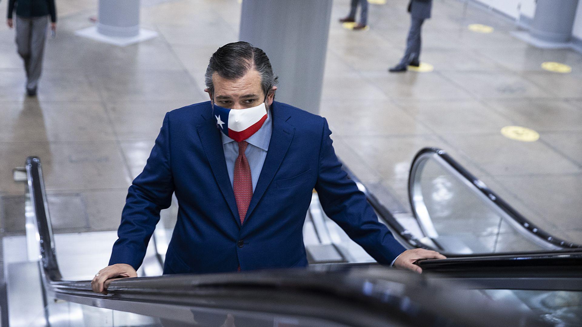 Senator Ted Cruz rides an escalator into the U.S. Capitol last month.