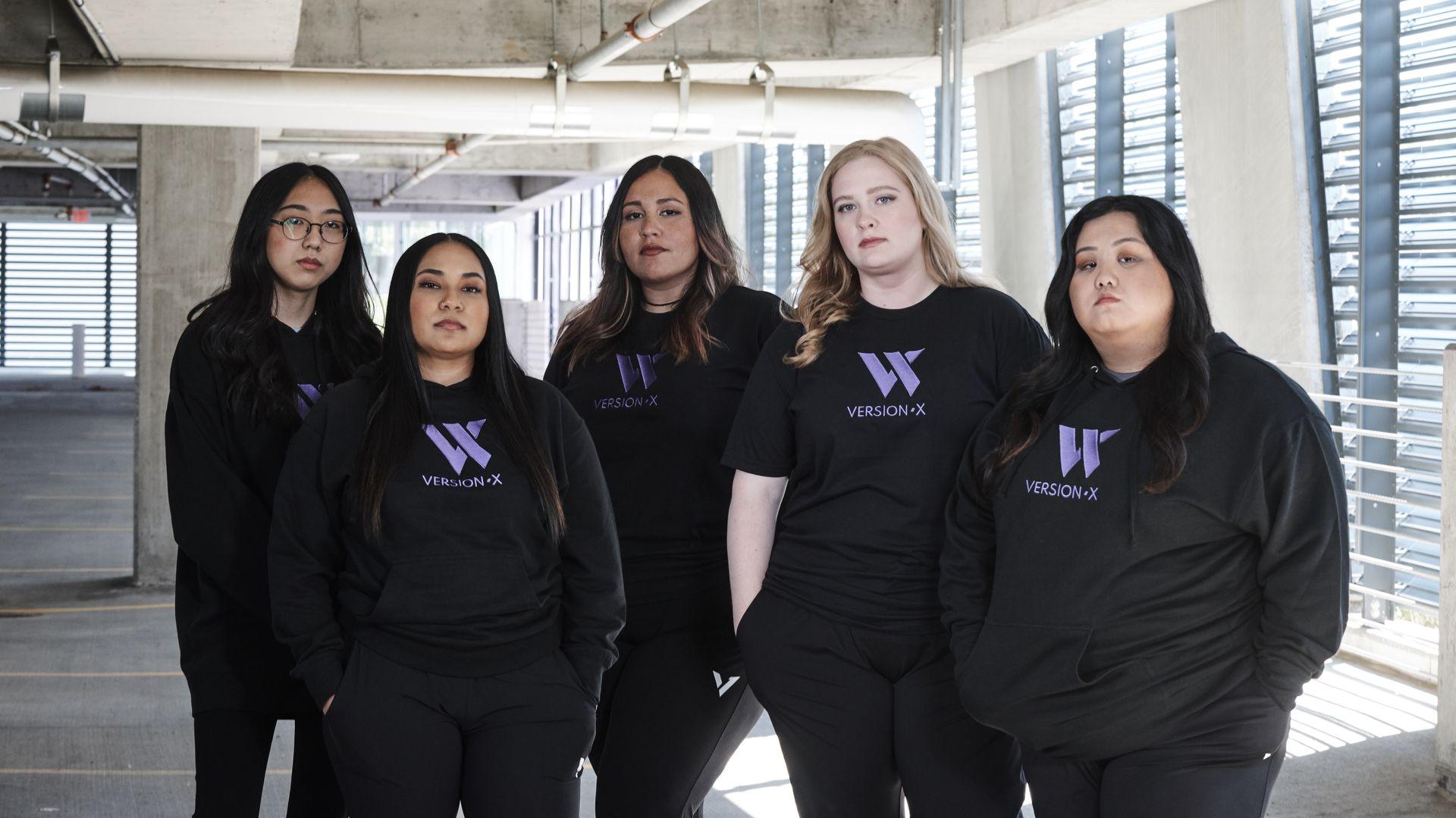 five women standing in parking garage in Versionx hoodies