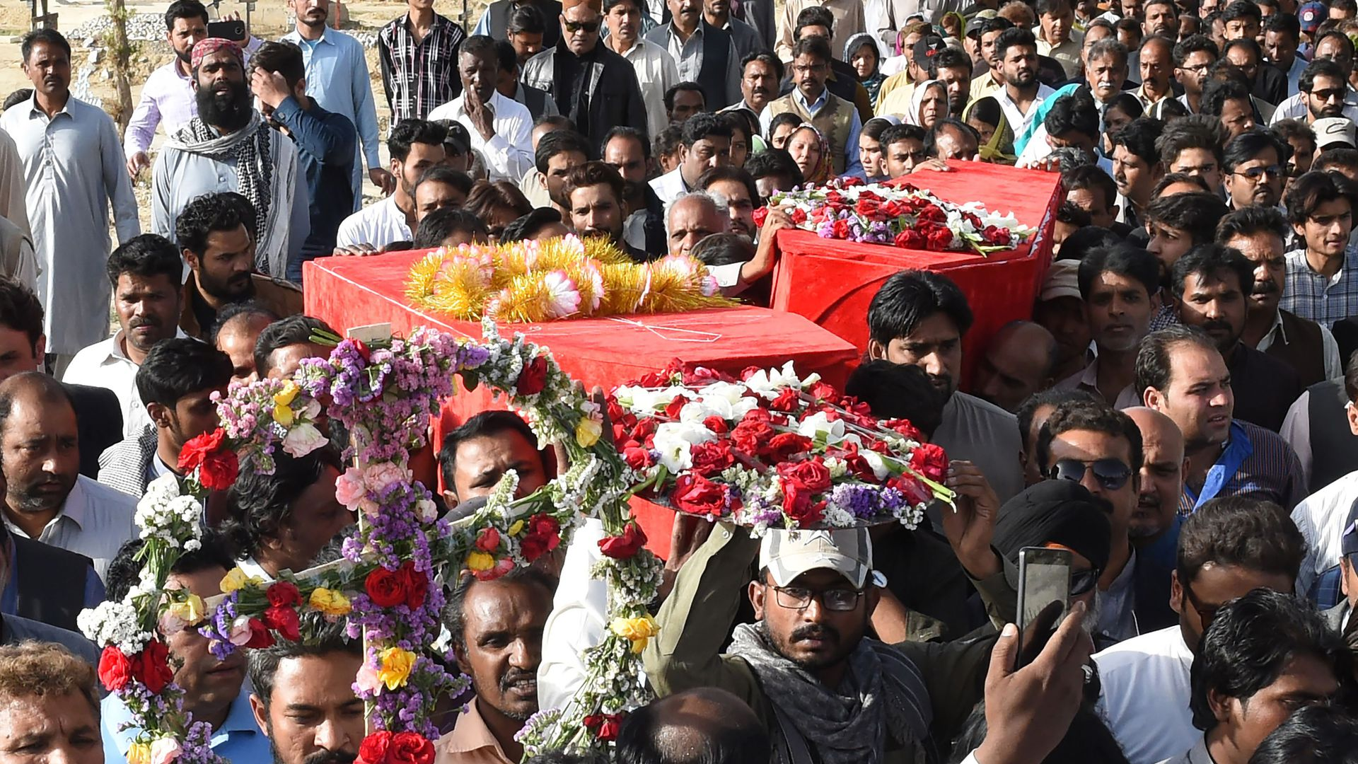 Southwest Pakistani Christians carrying a casket