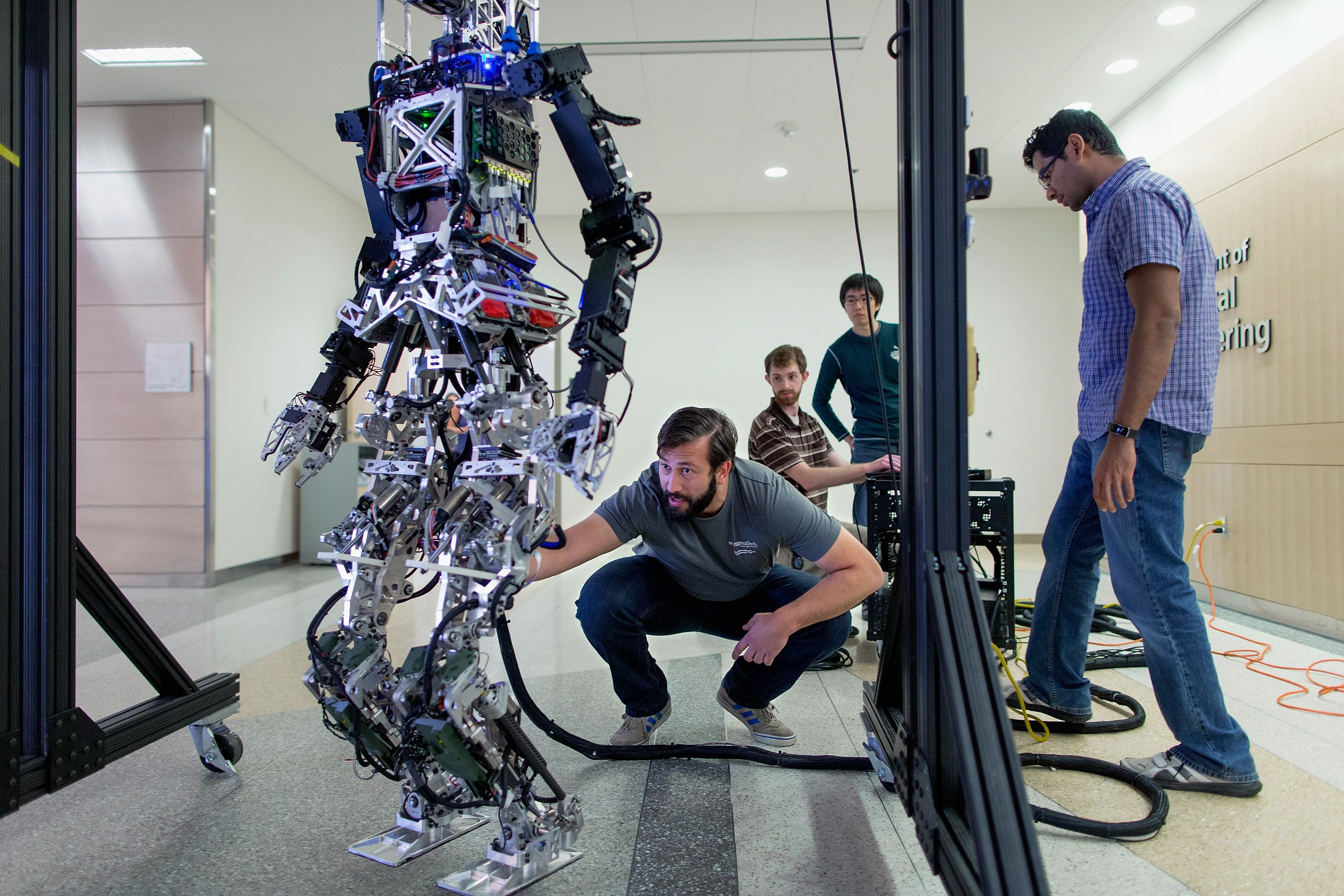 robot and four students