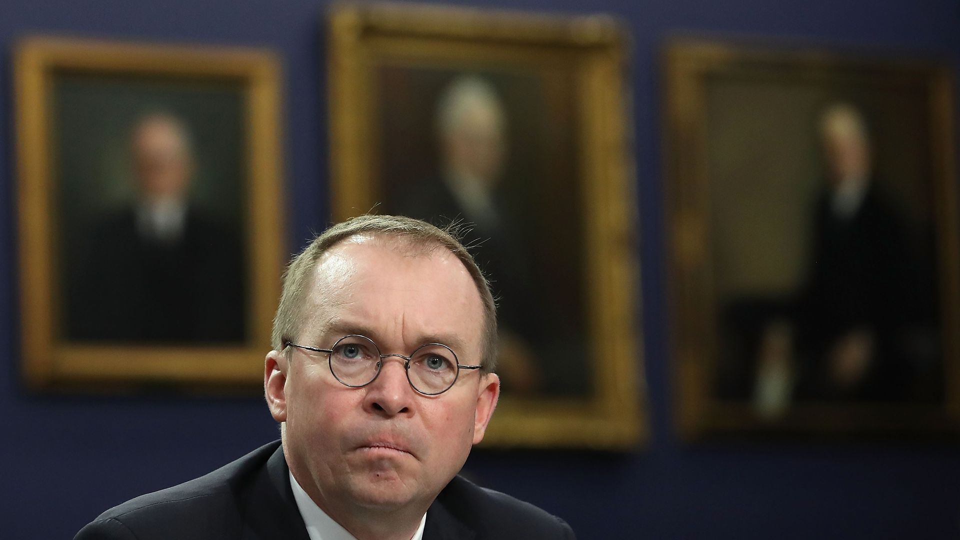 Mick Mulvaney looks concerned.