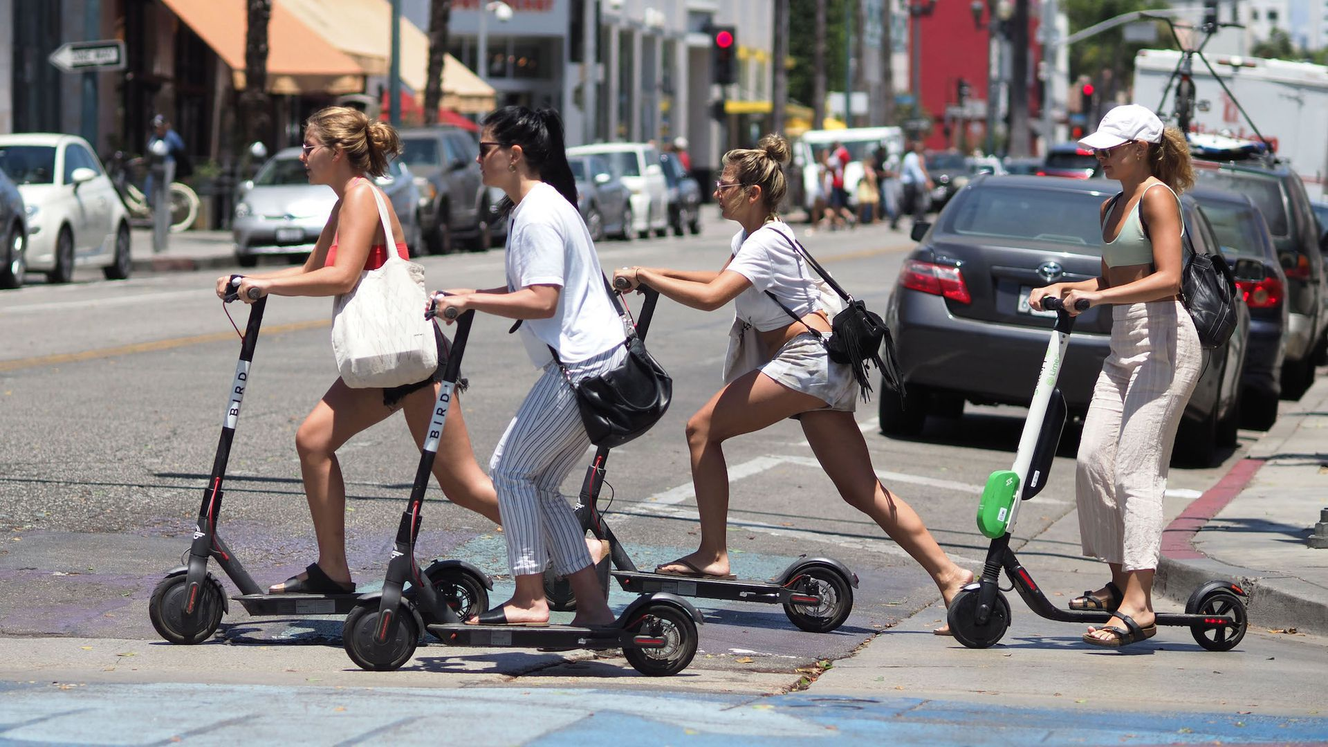Women riding electric scooters