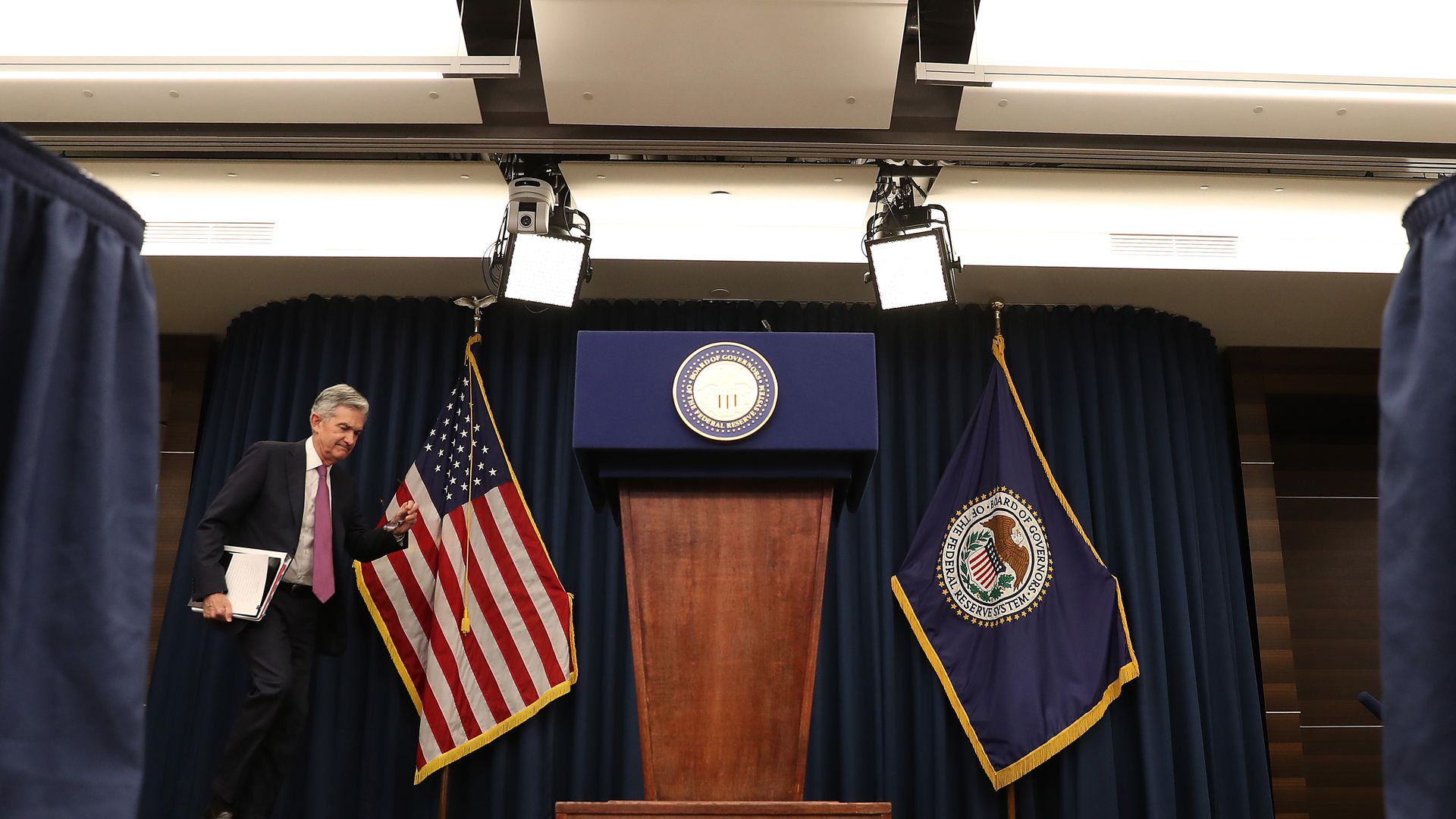 Federal Reserve Board Chairman Jerome Powell walks up to speak during a news conference.