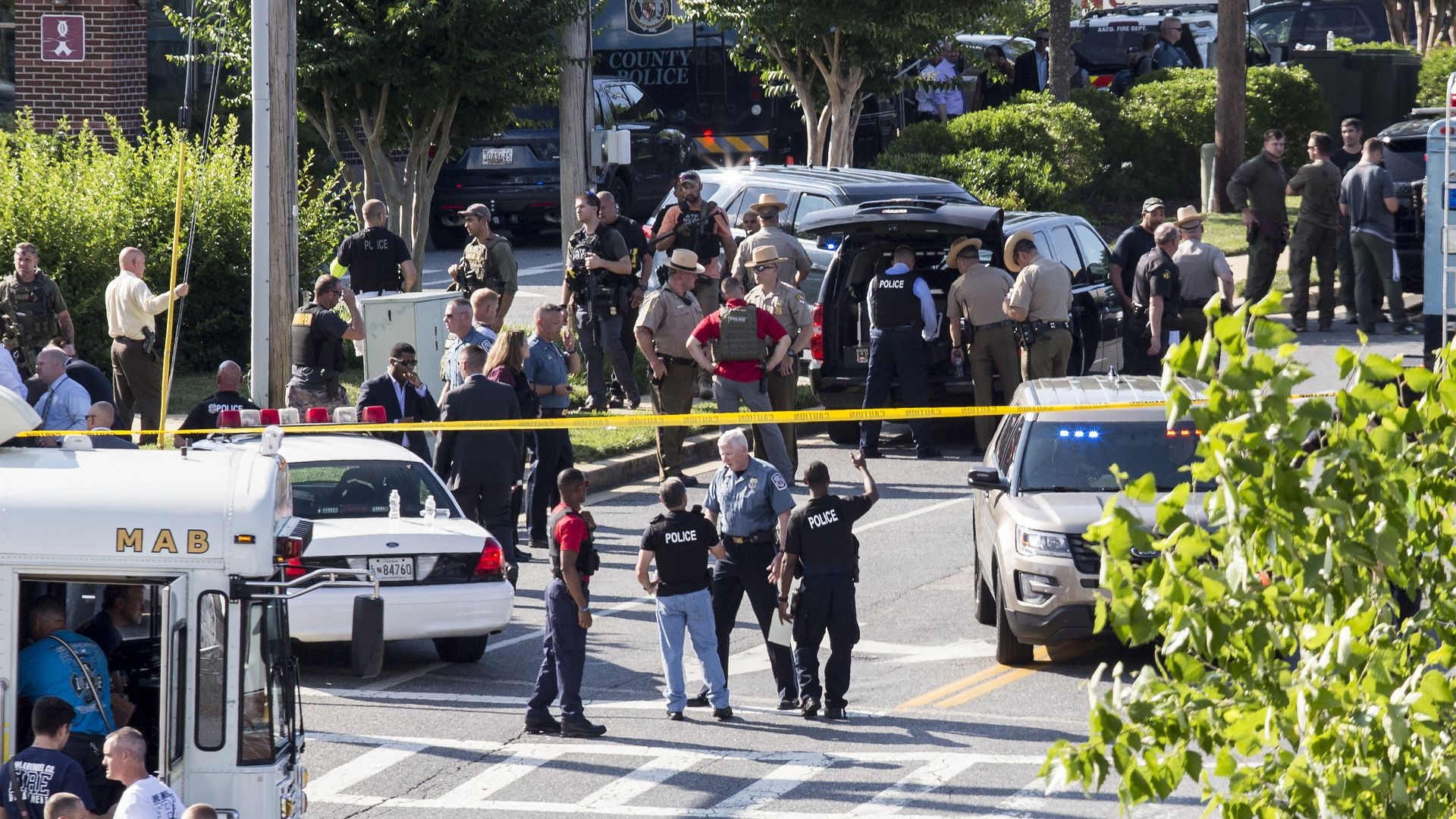 Police and press gathered on the scene of the shooting in Annapolis, Maryland.
