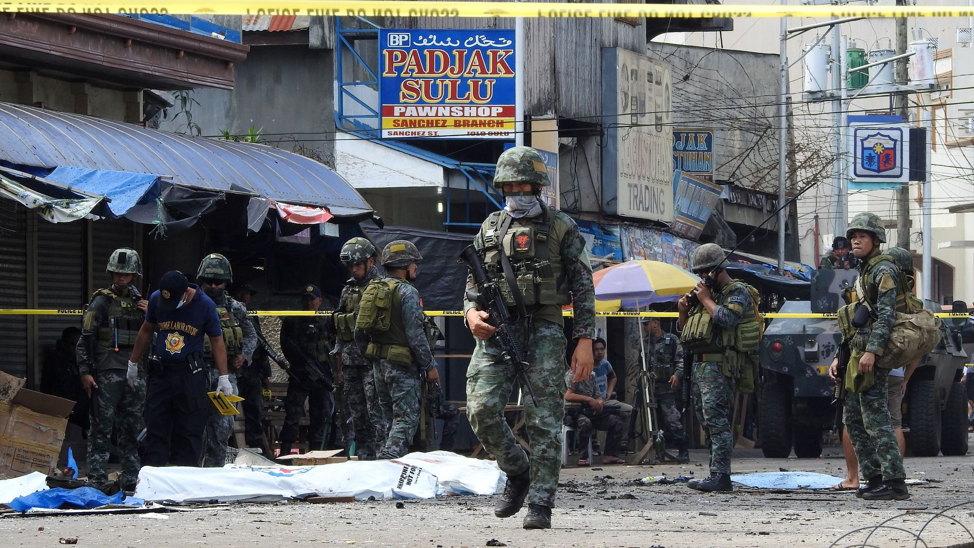 Military cleans up after bombs detonated in Philippines