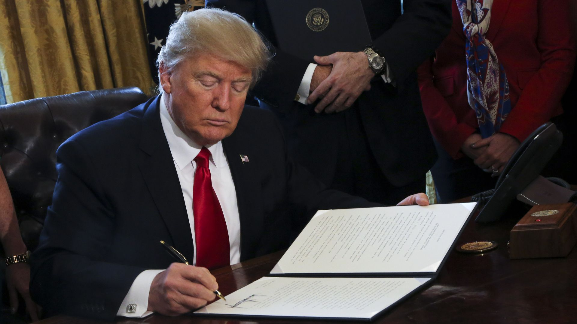 Trump signing an executive order