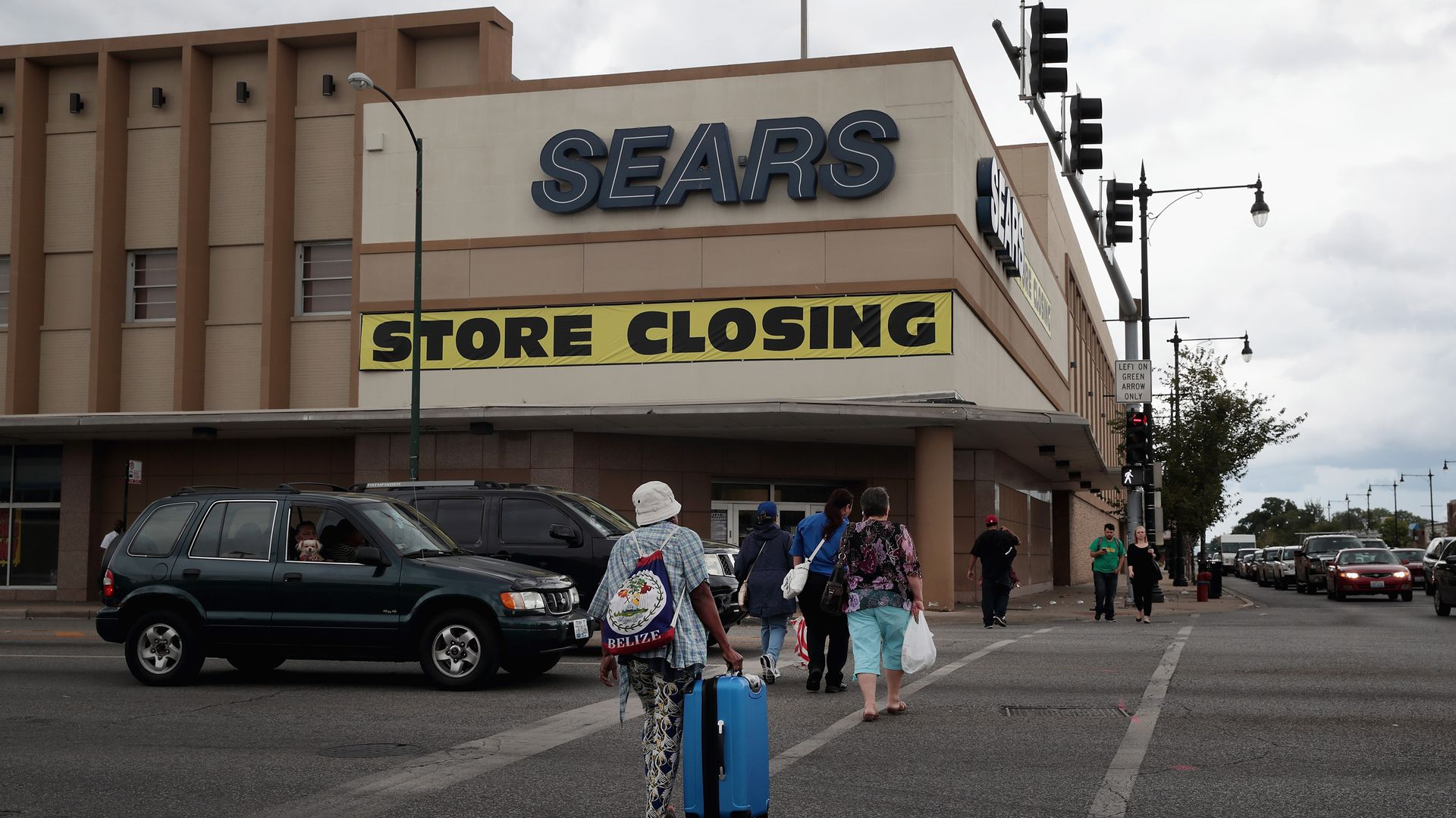"A Sears store with a ""store closing"" sign out front."