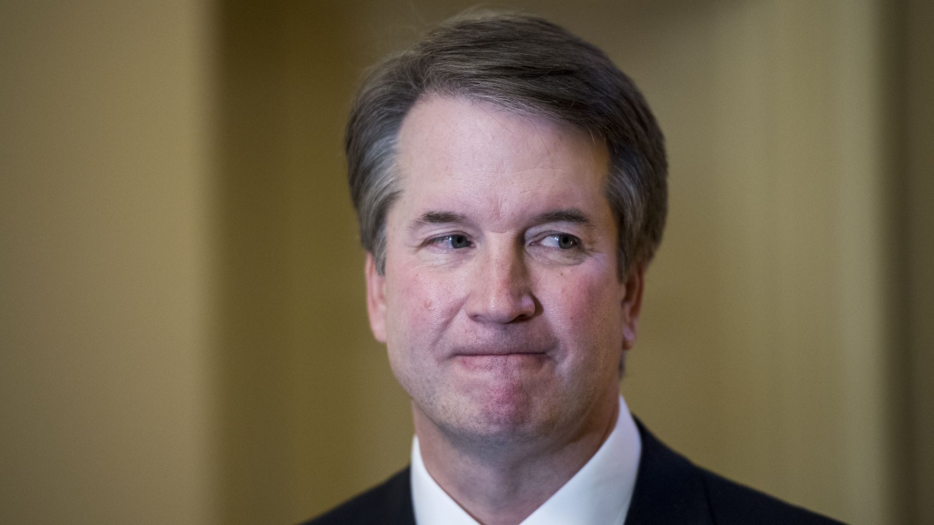 Close up of Brett Kavanaugh biting his lip