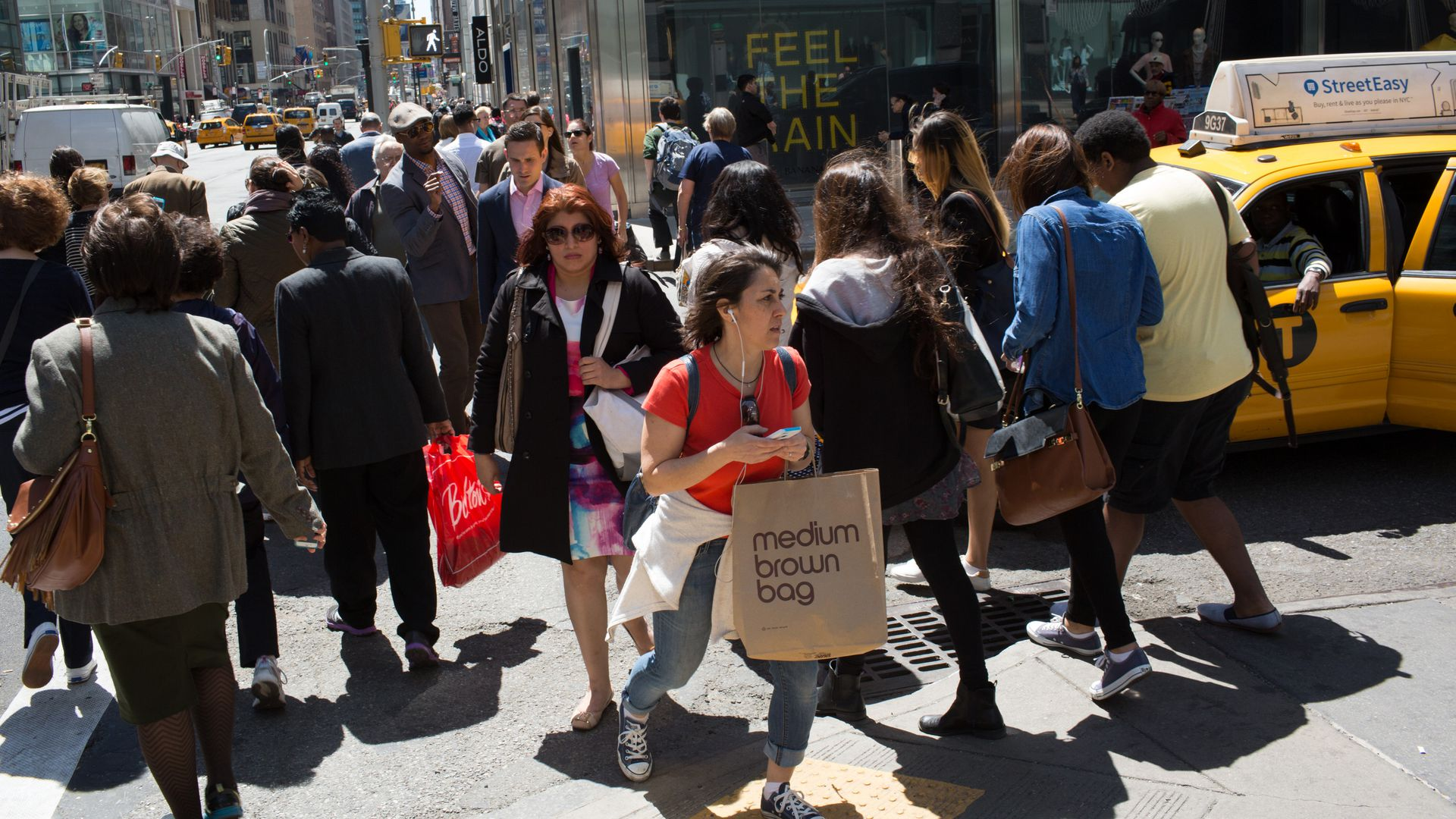 Shoppers walk through a crowded New York crosswalk